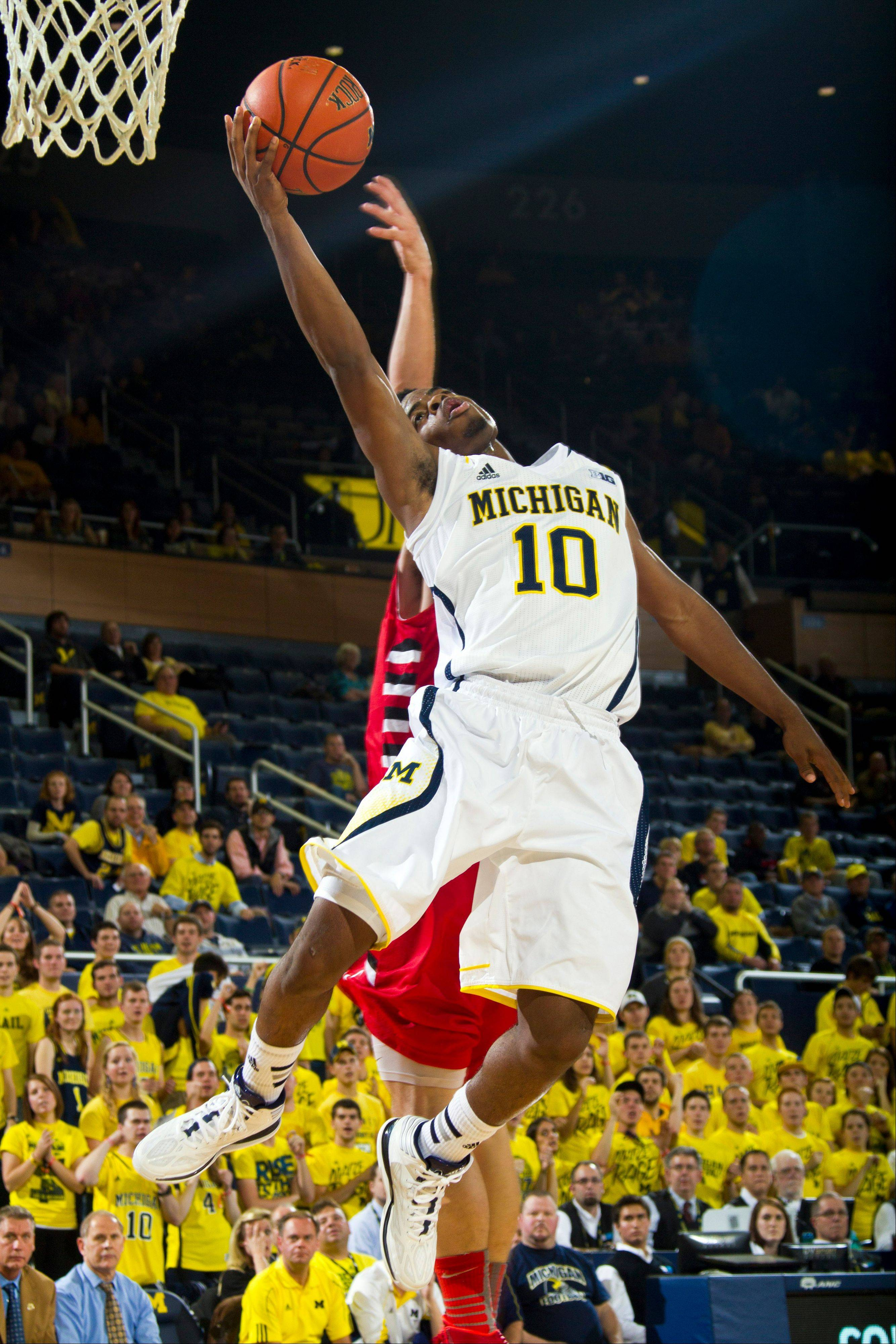Michigan guard Derrick Walton Jr. makes a layup in the second half of an exhibition game Tuesday against Concordia at Crisler Center in Ann Arbor, Mich. Michigan won 117-44.
