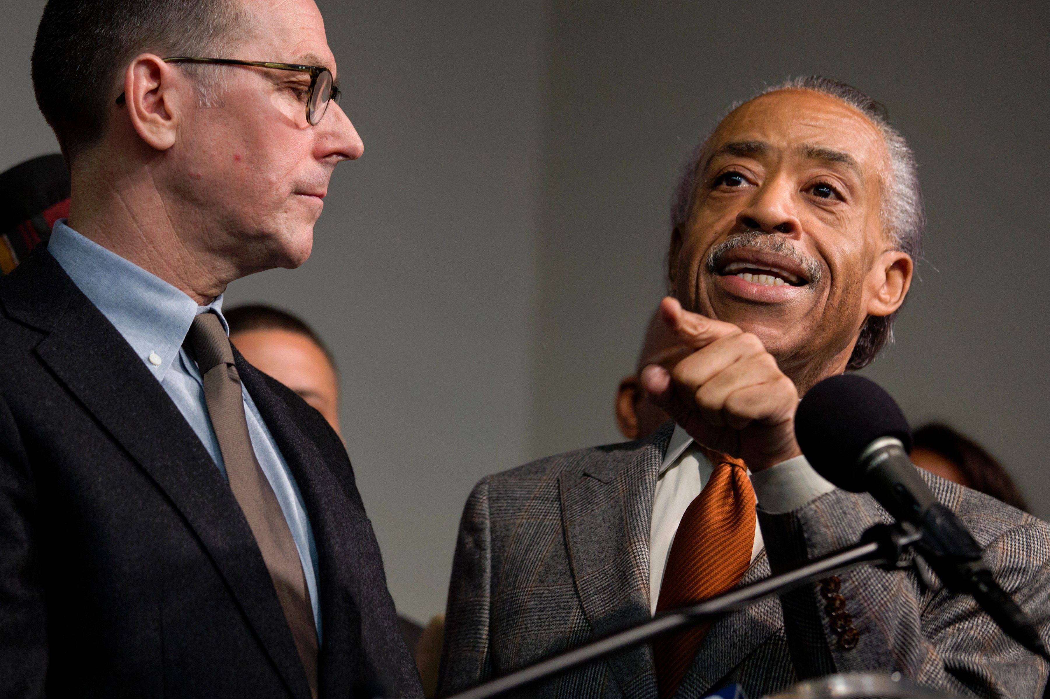The Rev. Al Sharpton, standing with Mark Lee, left, CEO of Barneys New York, addresses member of the media, at the National Action Headquarters in New York, after they and other community leaders discussed allegations of racial profiling. Two black customers recently claimed they were detained by police on suspicion of credit card fraud after lawfully purchasing expensive items.