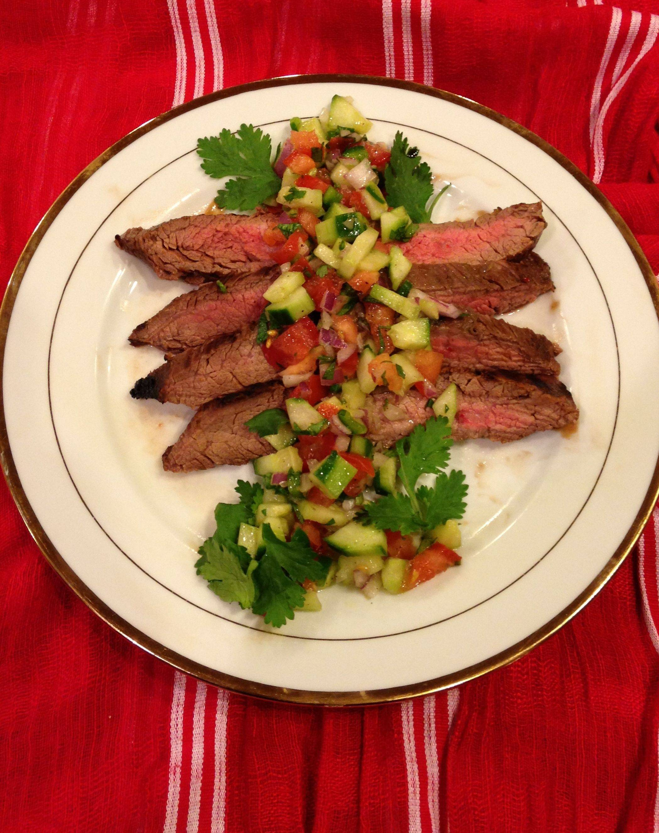 Lime gelatin and tequila flavor a marinade for flank steak. Serve it with a refreshing cucumber salsa.