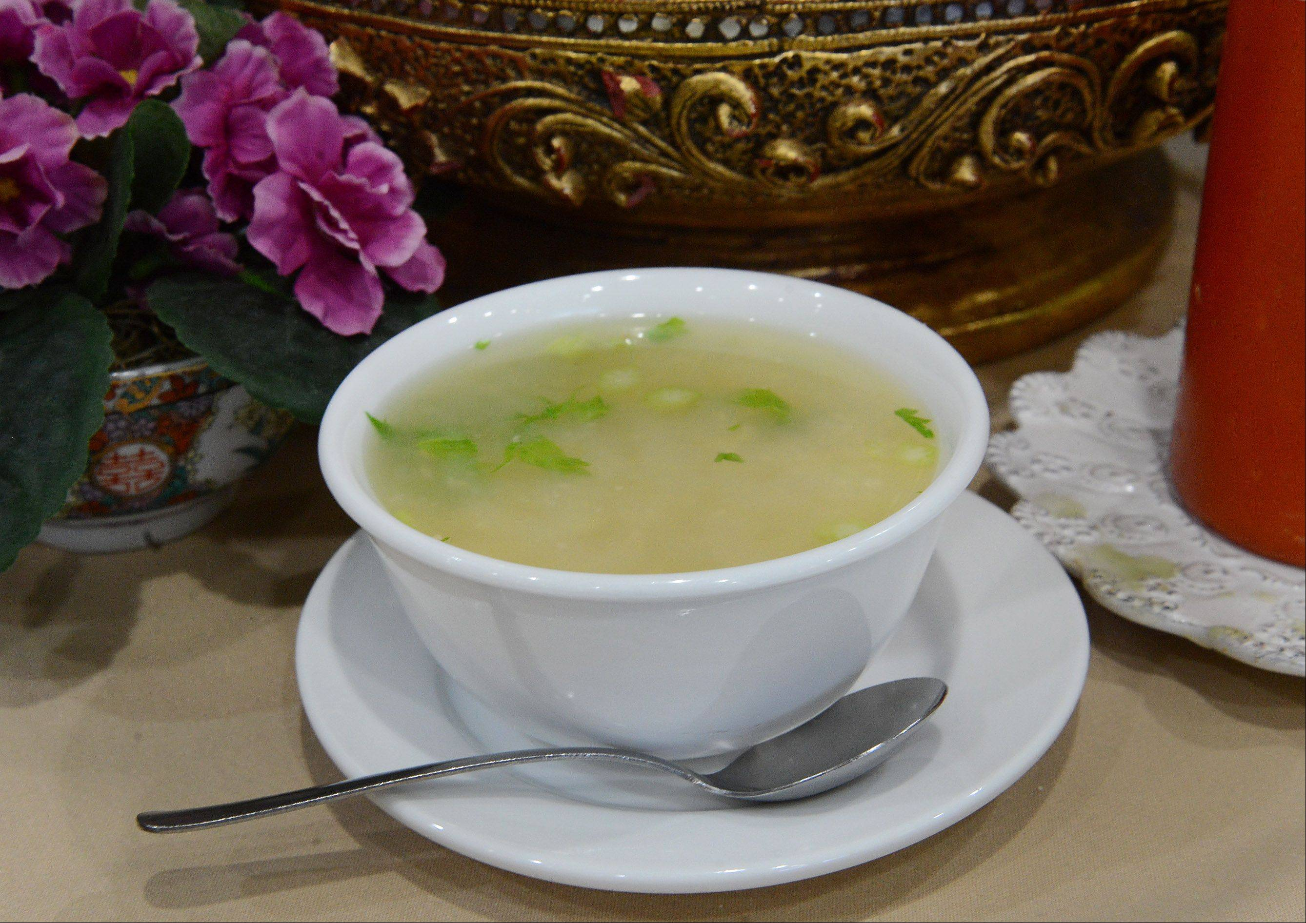 Green onions and jasmine rice mingle in Lovely Thai's rice soup.