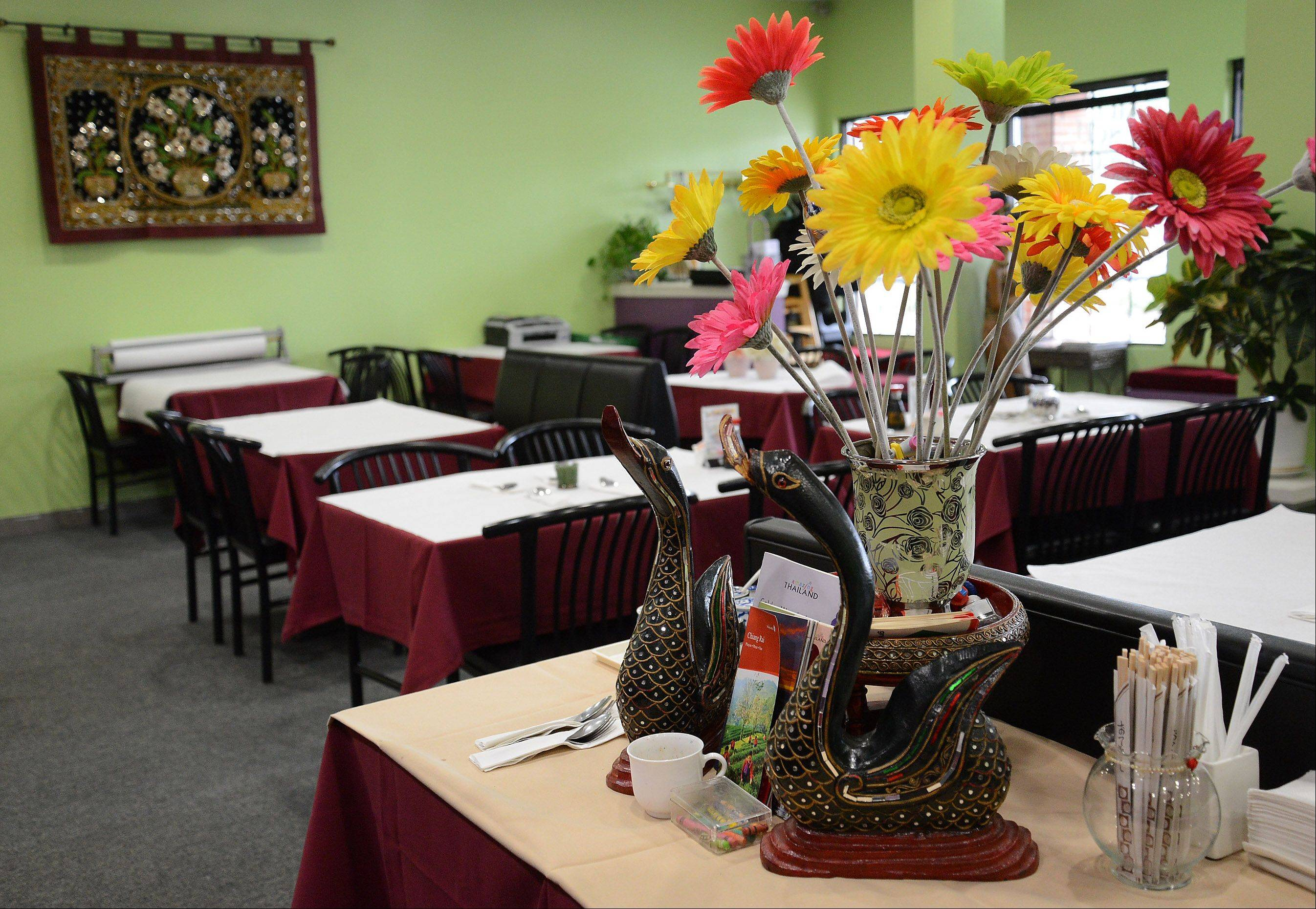 Vibrant green walls and fresh flowers welcome diners to Lovely Thai in Grayslake.