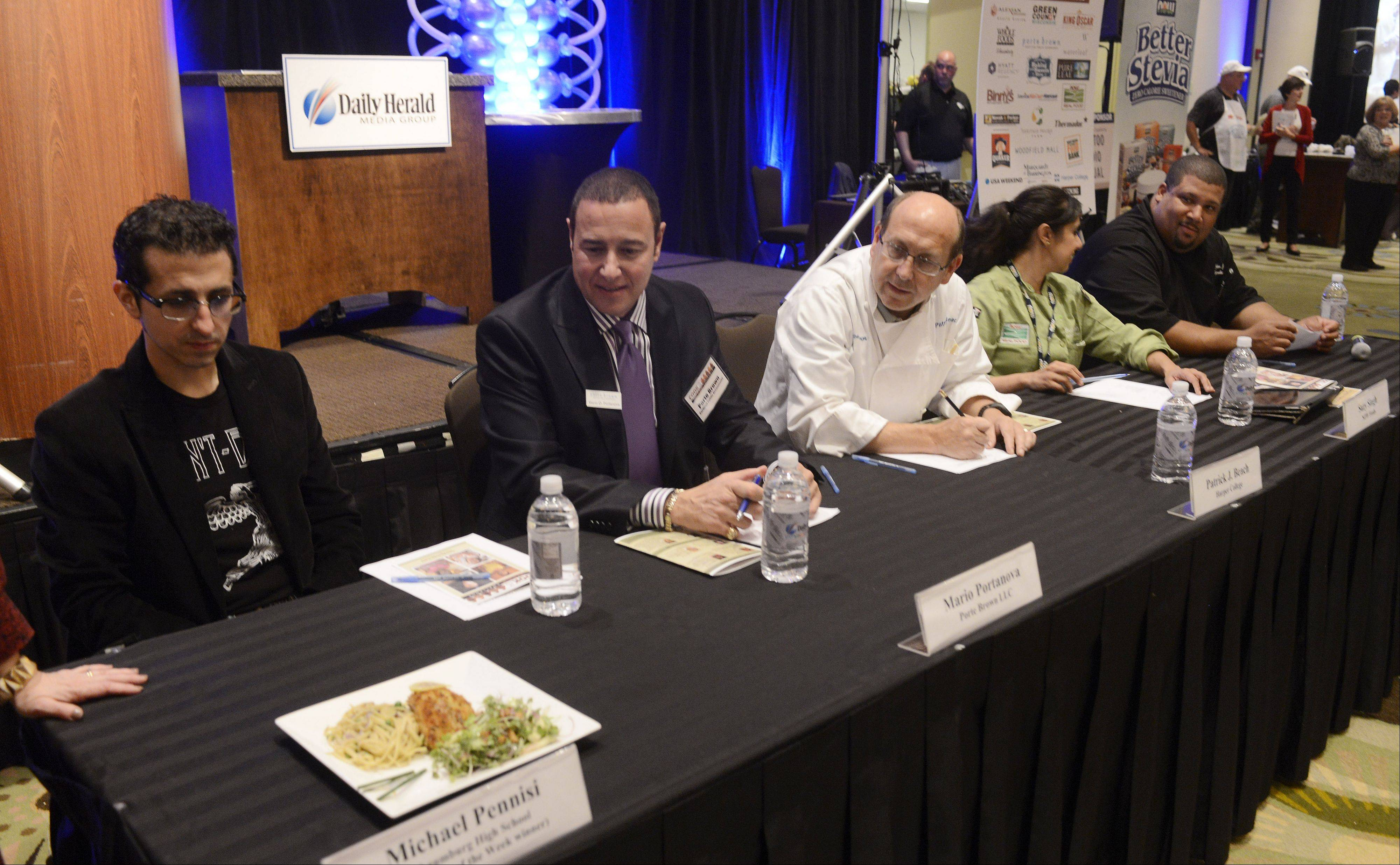 Judges wait to view and taste the first dish during the Daily Herald Cook of the Week Cookoff finals, held at the Hyatt Regency Schaumburg Wednesday.
