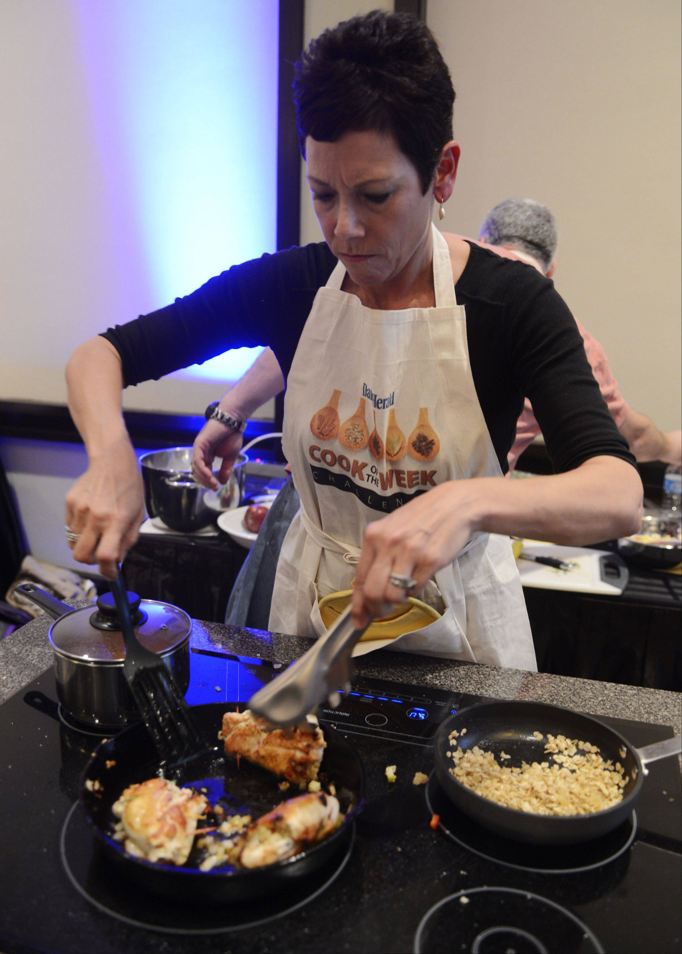 Lori Motyka of West Chicago turns her chicken during the Daily Herald Cook of the Week Cookoff finals, held at the Hyatt Regency Schaumburg Wednesday.