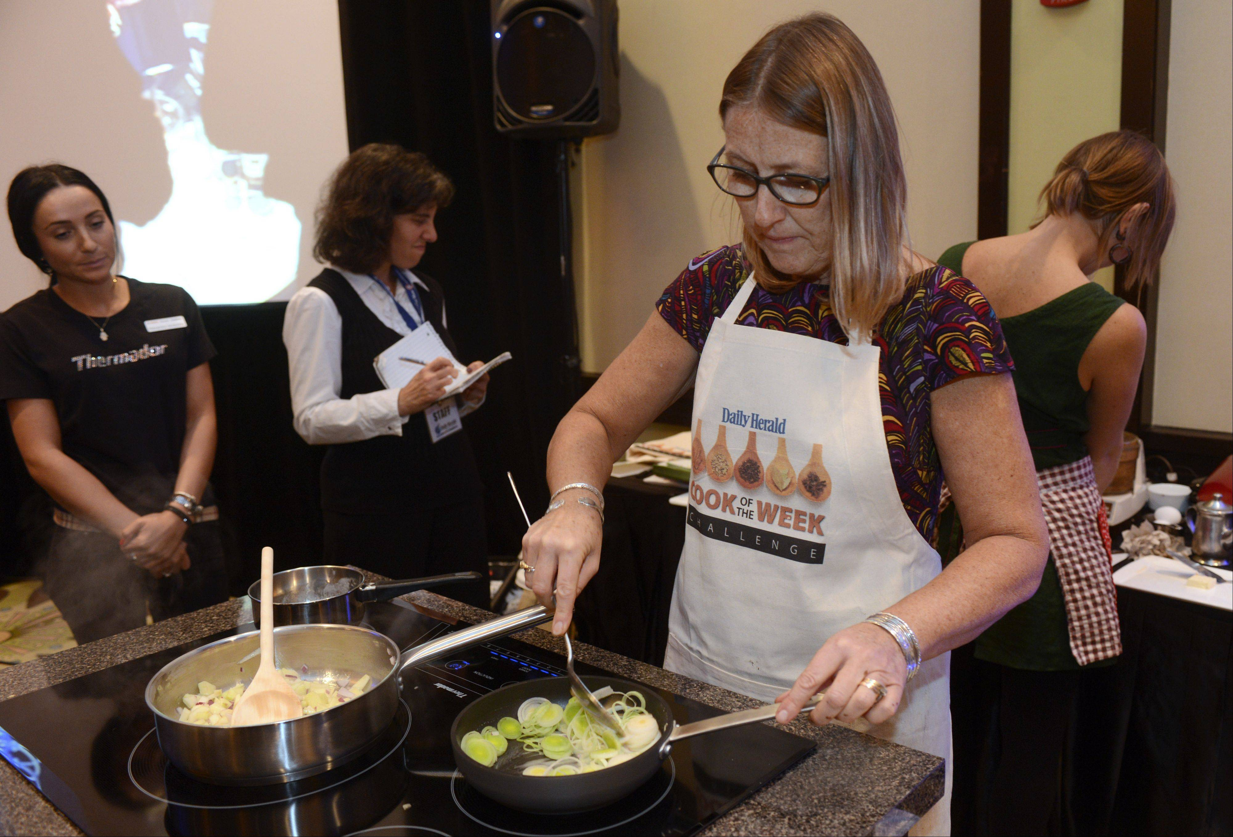 Christine Murphy of Palatine cooks during the Daily Herald Cook of the Week Cookoff finals, held at the Hyatt Regency Schaumburg Wednesday.