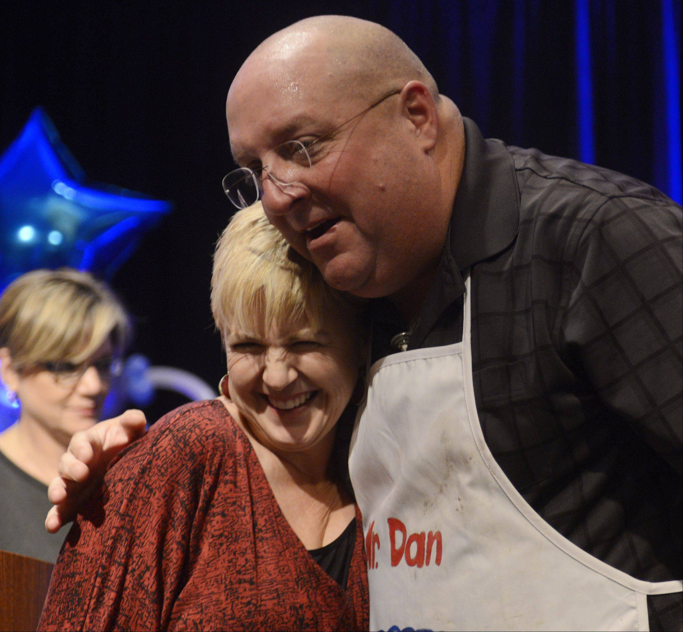 Dan Rich of Elgin hugs Daily Herald Food Editor Deb Pankey after being announced the winner of the Daily Herald Cook of the Week Cookoff finals, held at the Hyatt Schaumburg Wednesday.