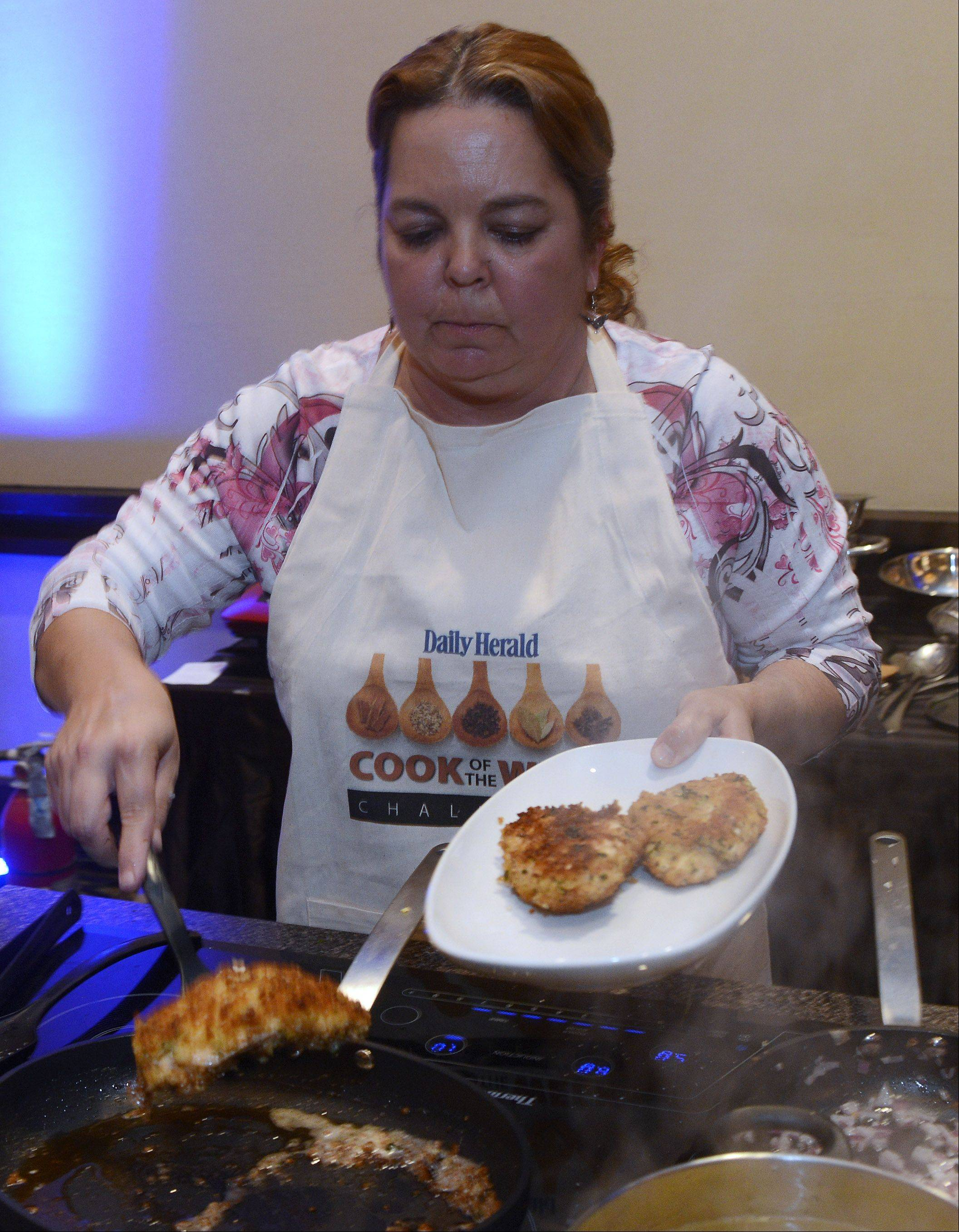 Lori Wiktorek of Aurora removes her chicken from the pan the Daily Herald Cook of the Week Cookoff finals, held at the Hyatt Regency Schaumburg Wednesday.