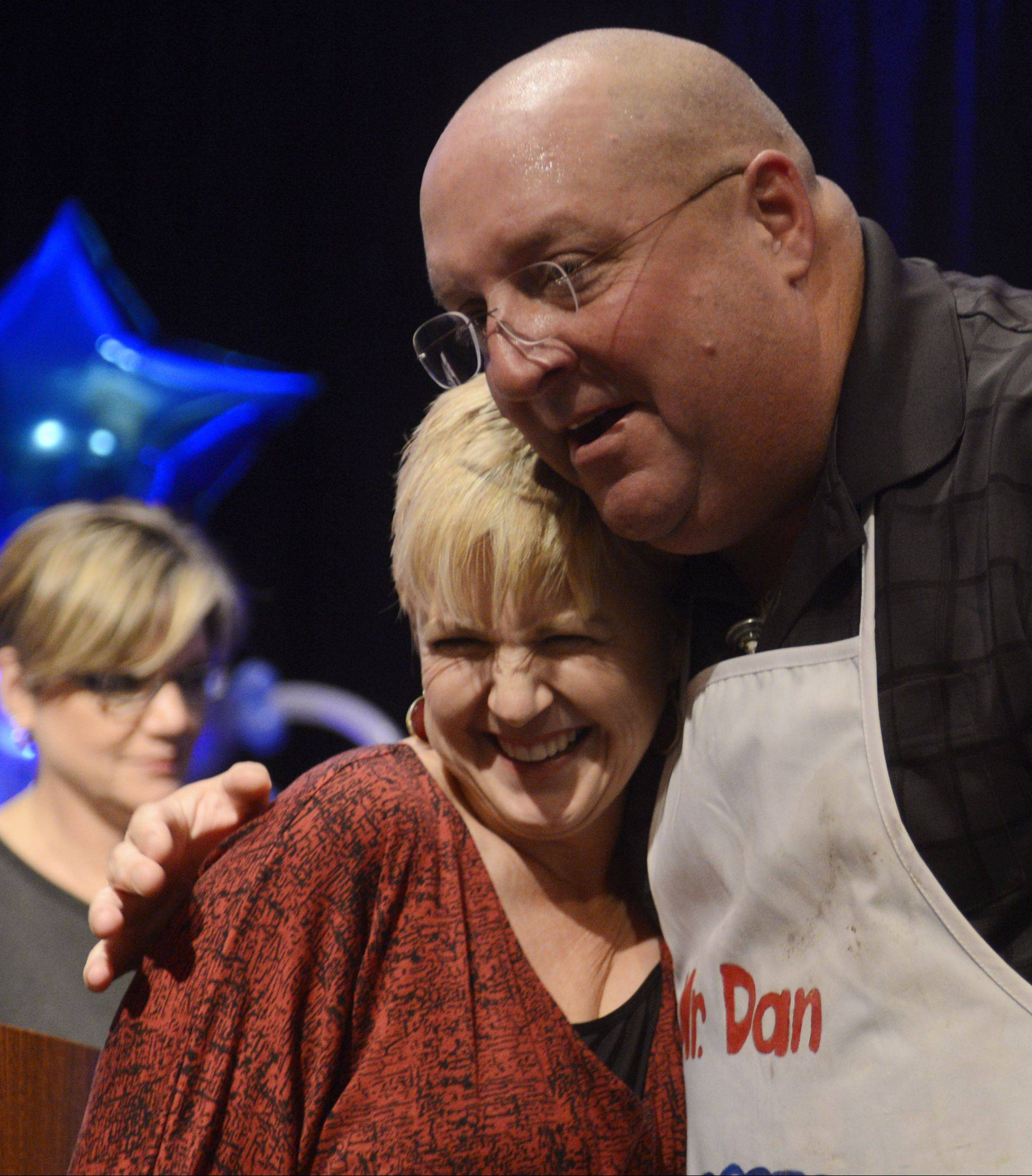Dan Rich of Elgin hugs Daily Herald Food Editor Deb Pankey after being announced the winner of the Daily Herald Cook of the Week Challenge finals, held Wednesday at the Hyatt Regency in Schaumburg.