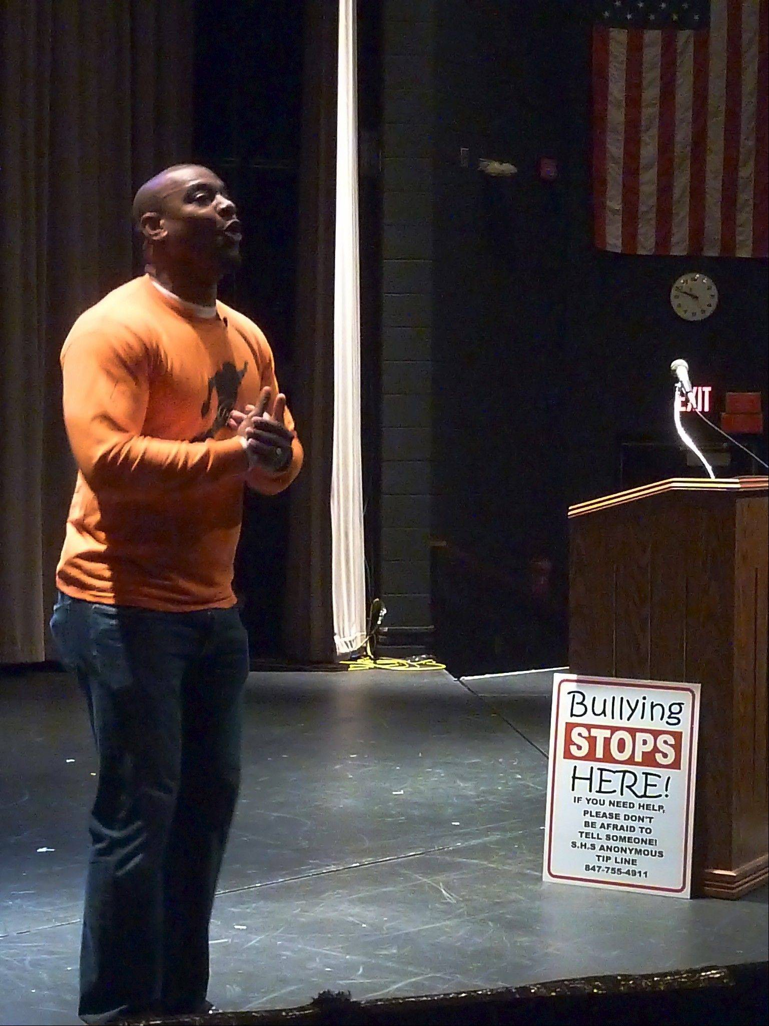 "Jarrett Payton speaks to students at Schaumburg High School about bullying on Wednesday. Payton, whose foundation supports anti-bullying efforts, appeared as part of the school's ""SHS Unites Day."""