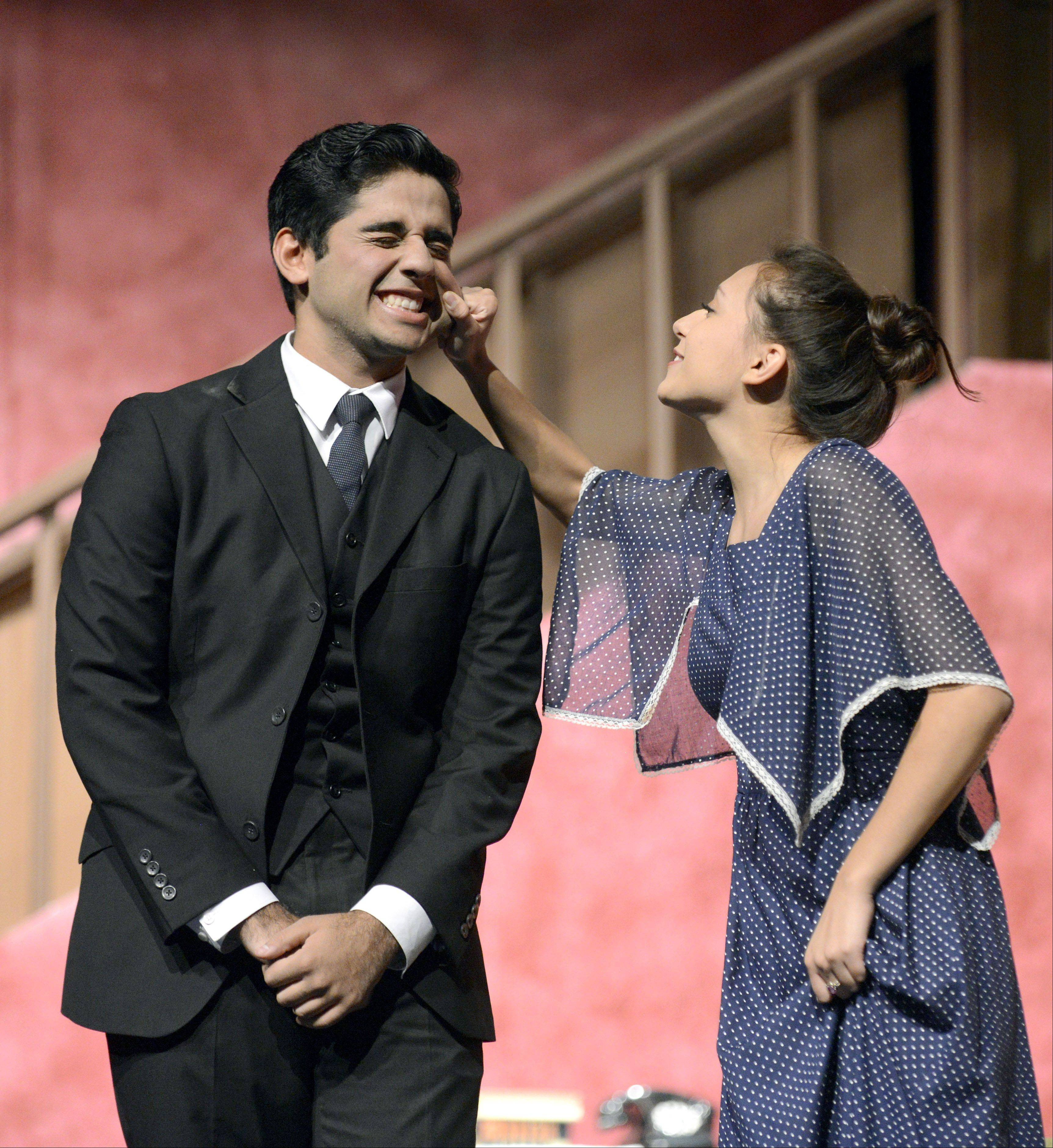 "Reza Khan portrays Mortimer Brewster, nephew of Abby Brewster, portrayed by Judith Palma in Elgin High School's production of ""Arsenic and Old Lace."" Shows are 7 p.m. Thursday and Friday and 11 a.m. Saturday, Oct. 31 to Nov. 2."