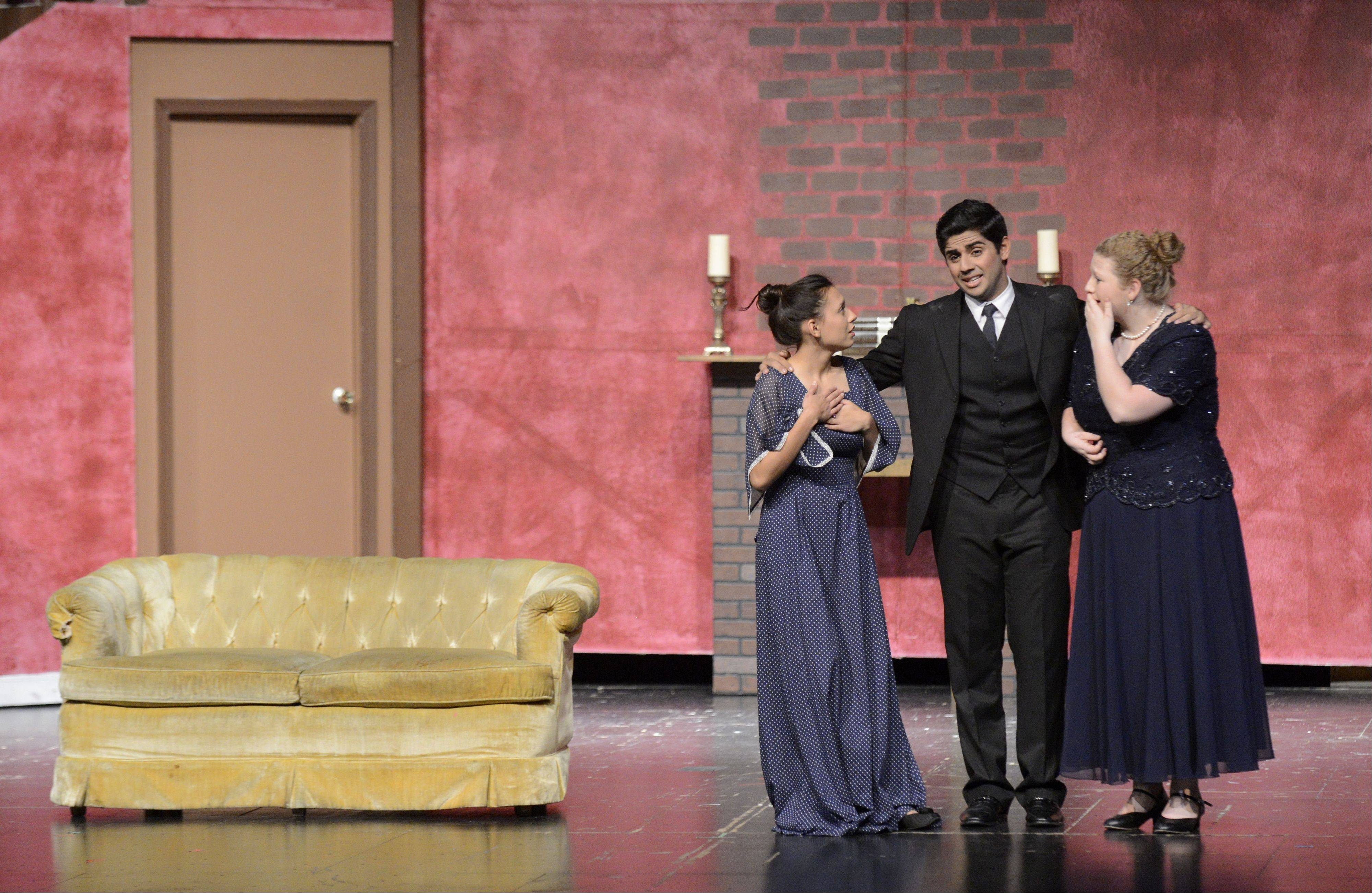 "From left, Judith Palma as Abby Brewster, Reza Khan as Mortimer Brewster, and Lauren Breu as Martha Brewster rehearse for Elgin High School's production of ""Arsenic and Old Lace."""