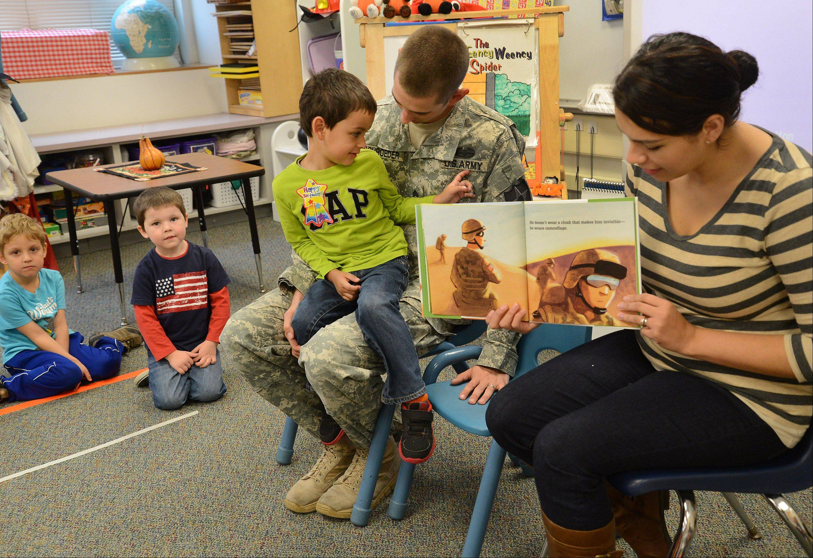 "U.S. Army Sgt. Robert Schroeder of Lake Barrington received a hero's welcome Wednesday at St. Anne Parish School in Barrington. Schroeder had planned to surprise his son William, a pre-Kindergarten student at the school, with his return for a two-week leave, but instead students and staff surprised him with their greeting. ""It's been shocking and an honor,"" he said."
