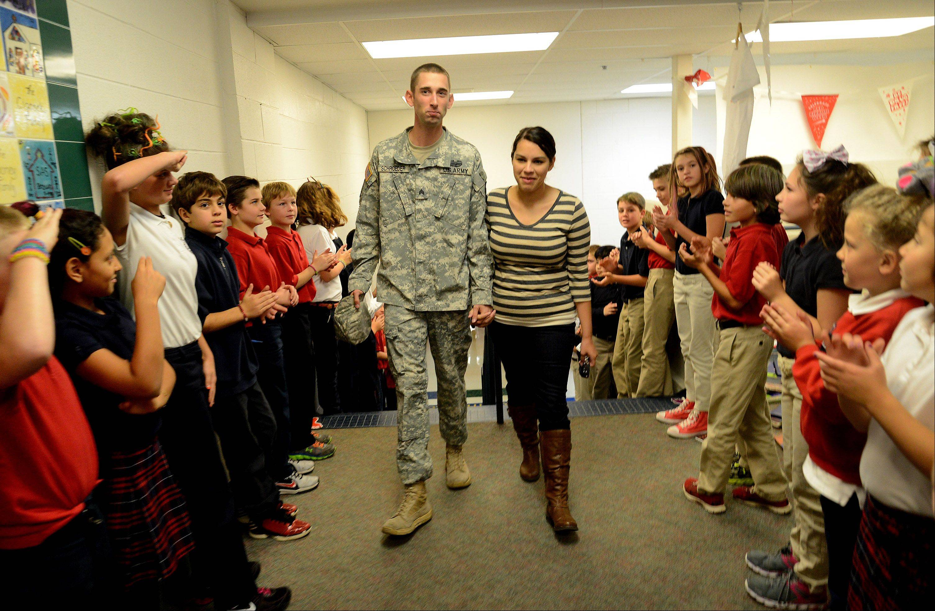 U.S. Army Sgt. Robert Schroeder of Lake Barrington received a surprise hero's welcome Wednesday at St. Anne School in Barrington. Home on a two-week leave from his assignment in South Korea, Schroeder planned on surprising his 4-year-old son William in his pre-Kindergarten class.