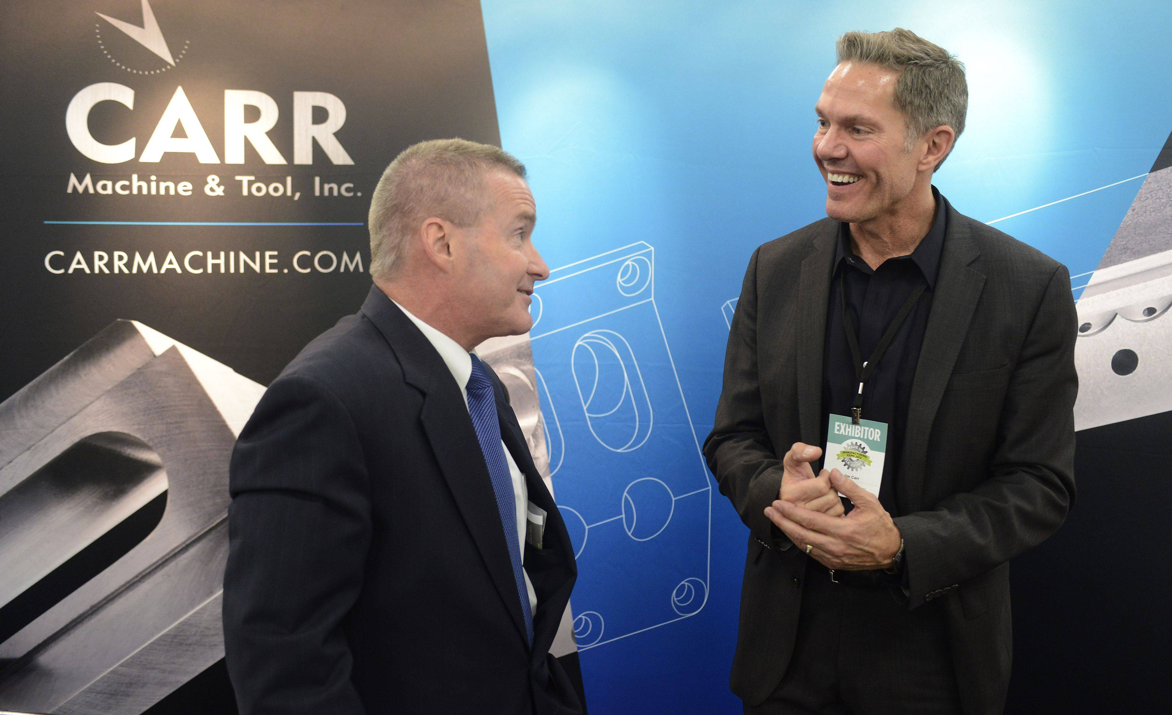 JOE LEWNARD/jlewnard@dailyherald.comElk Grove Village Mayor Craig Johnson, left, chats with Jim Carr, President of Carr Machine & Tool, Inc., during the Elk Grove Village business expo Tuesday.