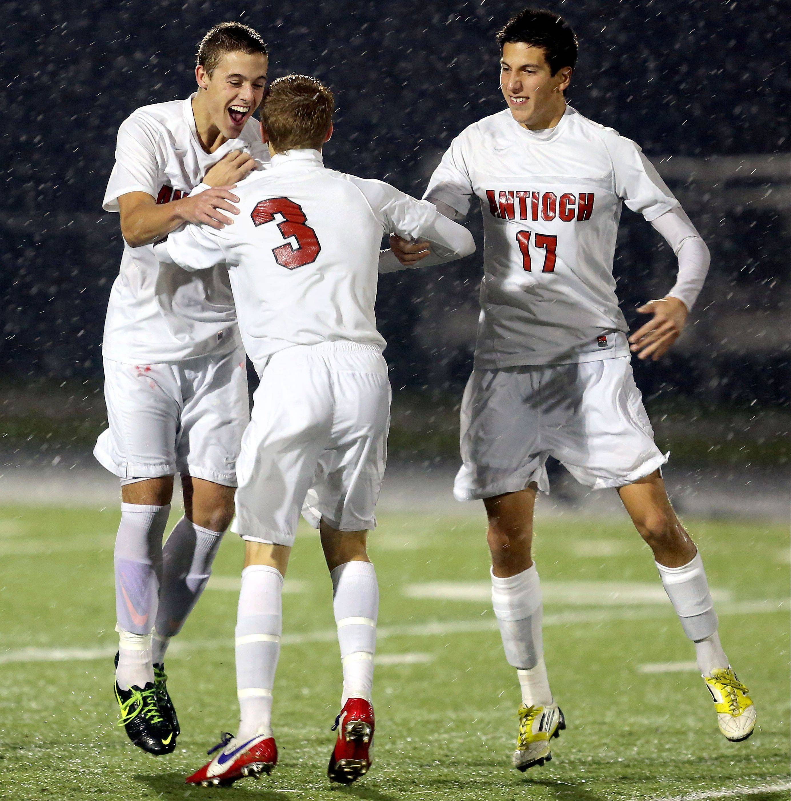 Antioch's Eric Pedersen, left, and RJ Ruano celebrate with Danny Brito (3) after his second goal on a throw-in during their Class 3A sectional semifinal against Grayslake Central on Wednesday.