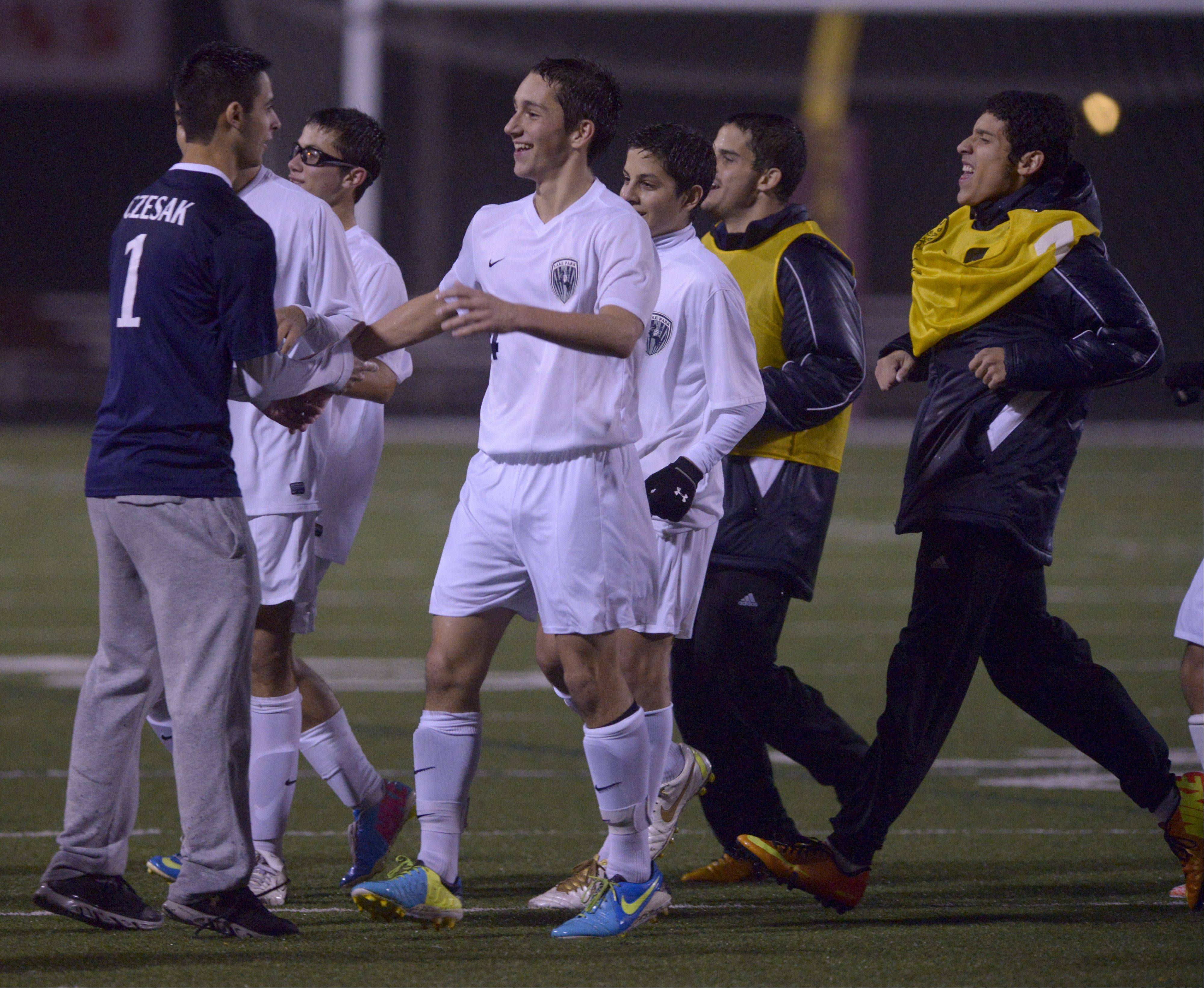 Lake Park players celebrates their win over Elk Grove during the Class 3A Schaumburg sectional semifinals Wednesday.