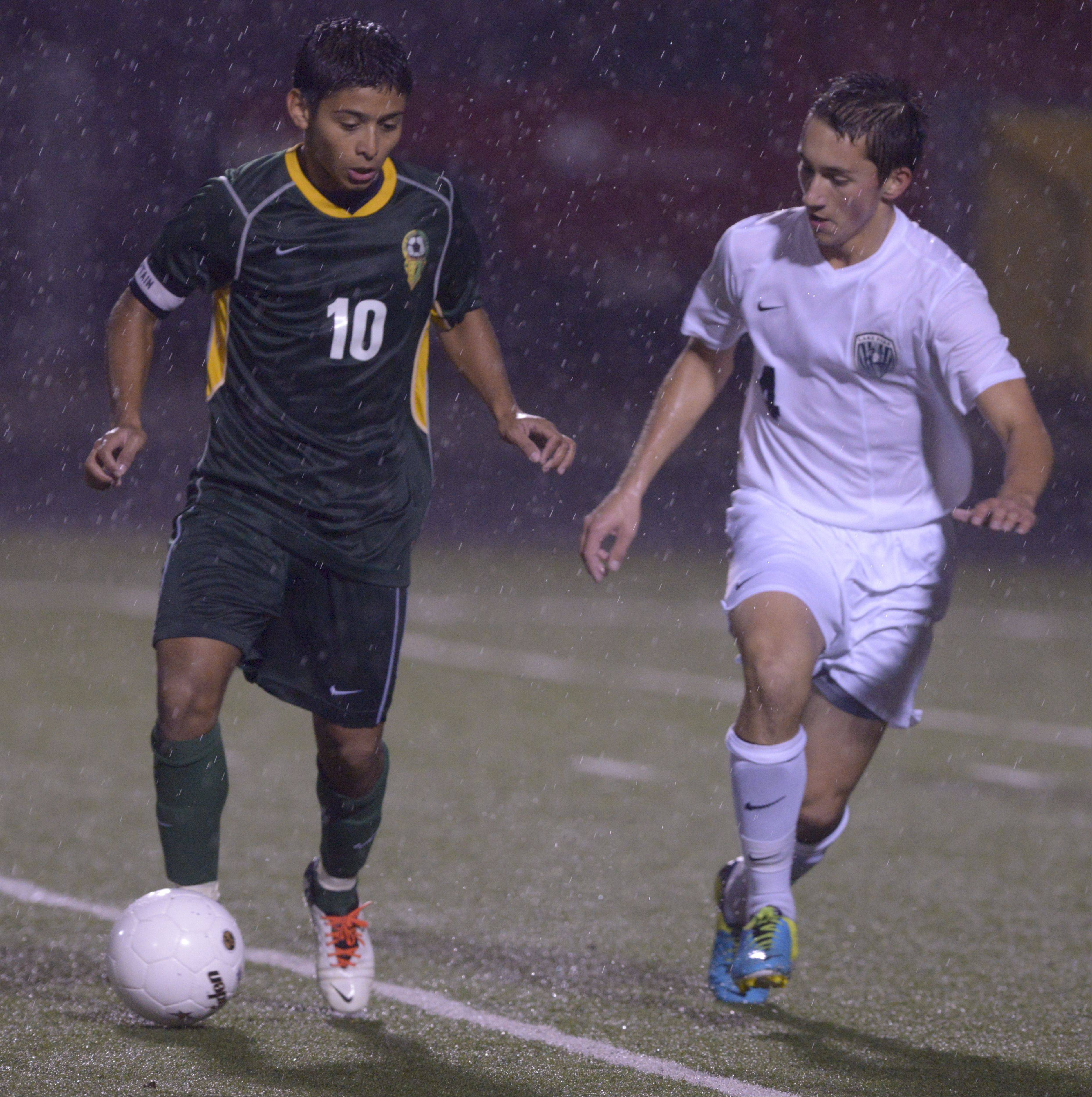 Jonathon Arzeta of Elk Grove and Anthony Devereux of Lake Park battle for control of the ball during in the Class 3A Schaumburg sectional semifinals Wednesday.