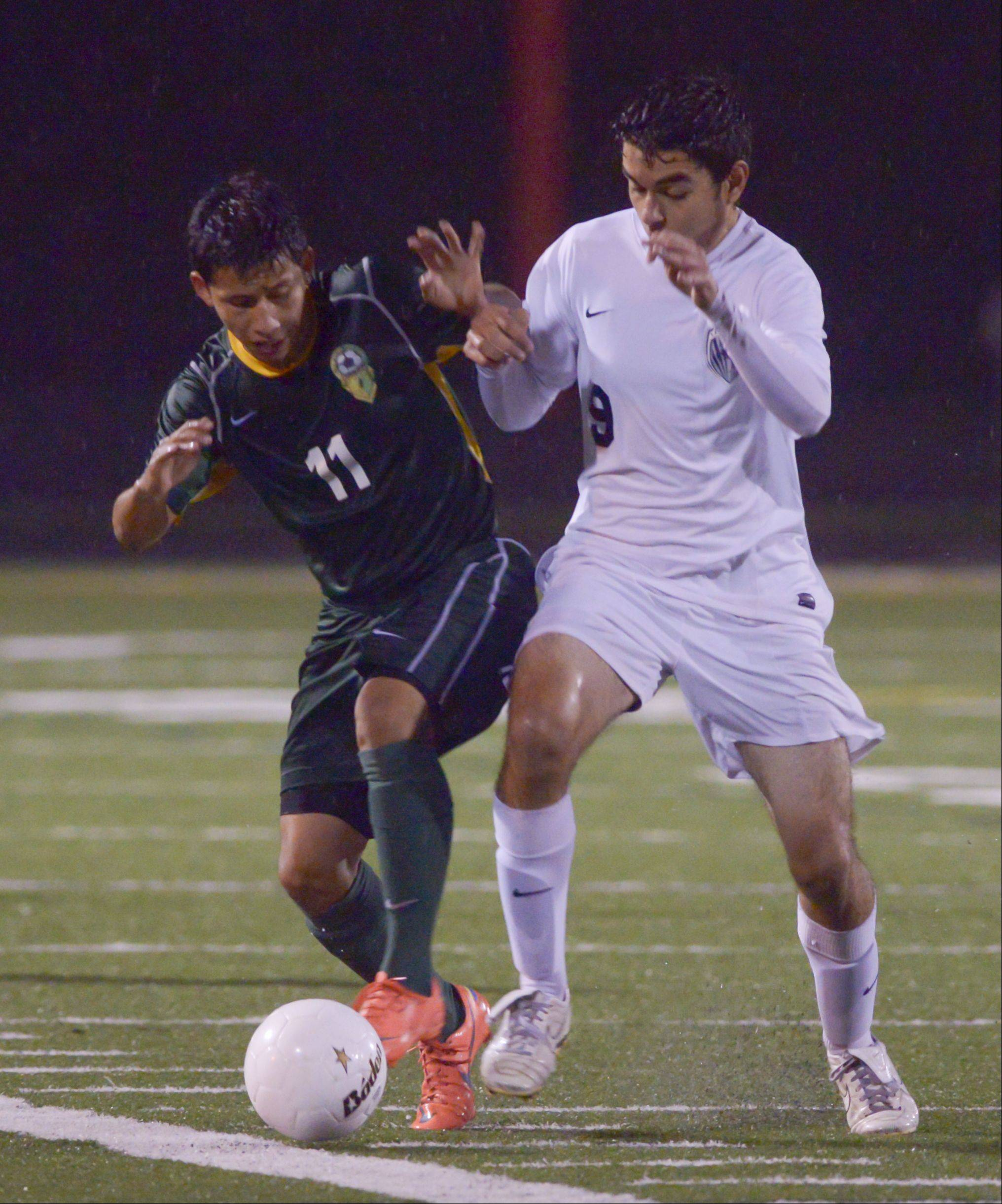 Carlos Miranda of Elk Grove and Carlos Torres of Lake Park battle for control of the ball during in the Class 3A Schaumburg sectional semifinals Wednesday.