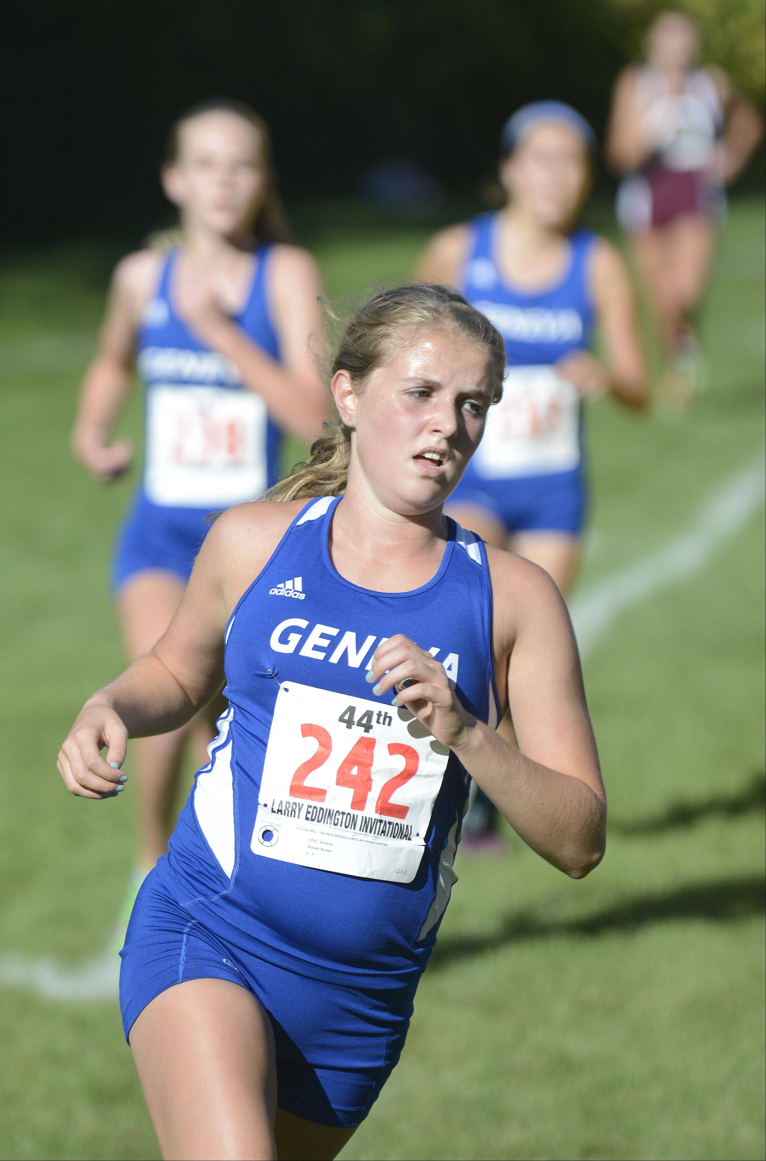 Geneva's Brooke Nusser leads teammates Emma McSpadden and McKenzie Altmayer to the finish line, taking seventh place, with Altmayer taking eighth place and McSpadden taking ninth place at the Kaneland Invitational cross country meet in Elburn on Saturday, September 21.
