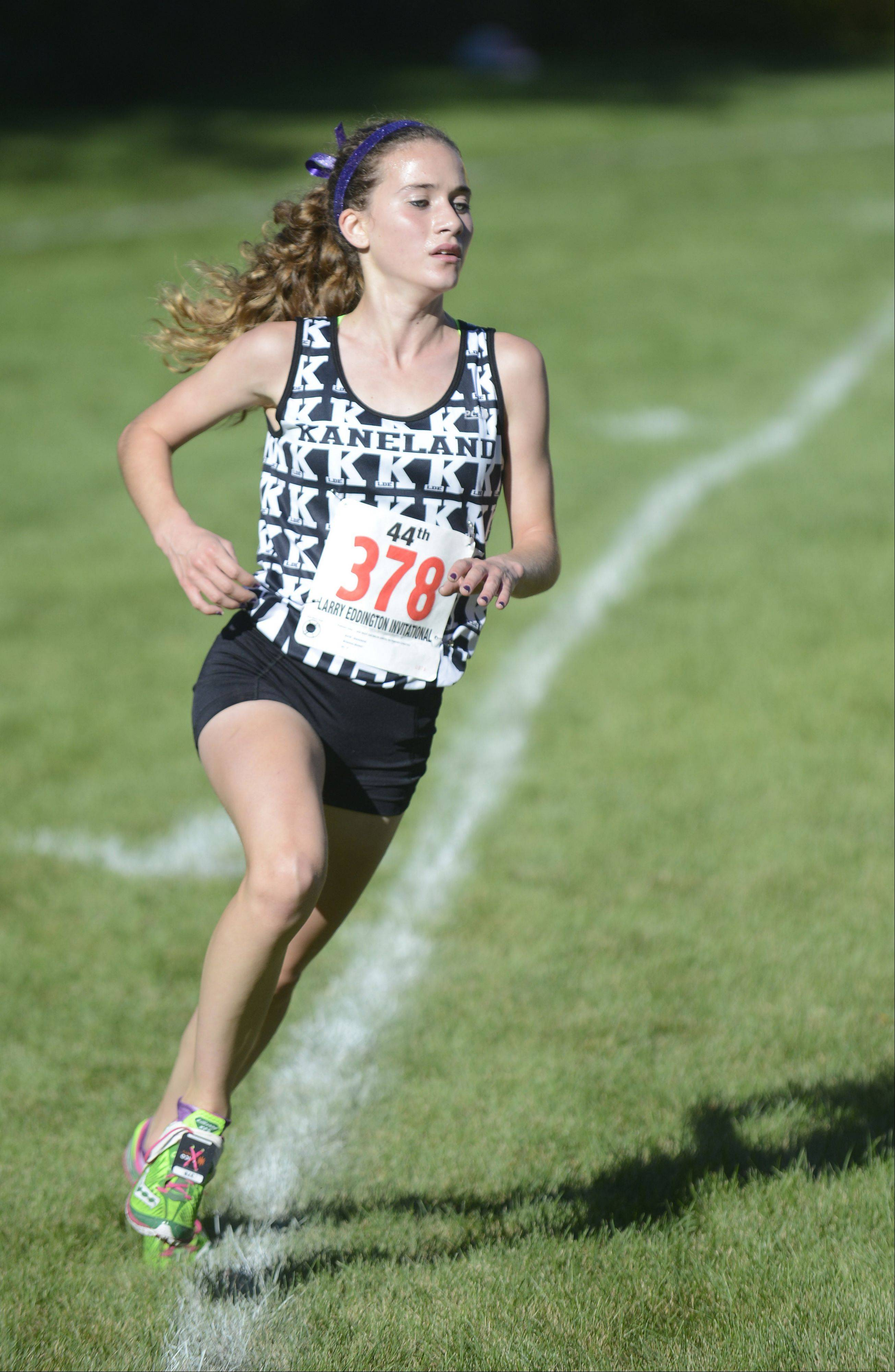 Laura Stoecker/lstoecker@dailyherald.com � Kaneland's Brianna Bower takes fifth place at the Kaneland Invitational cross country meet in Elburn on Saturday, September 21.