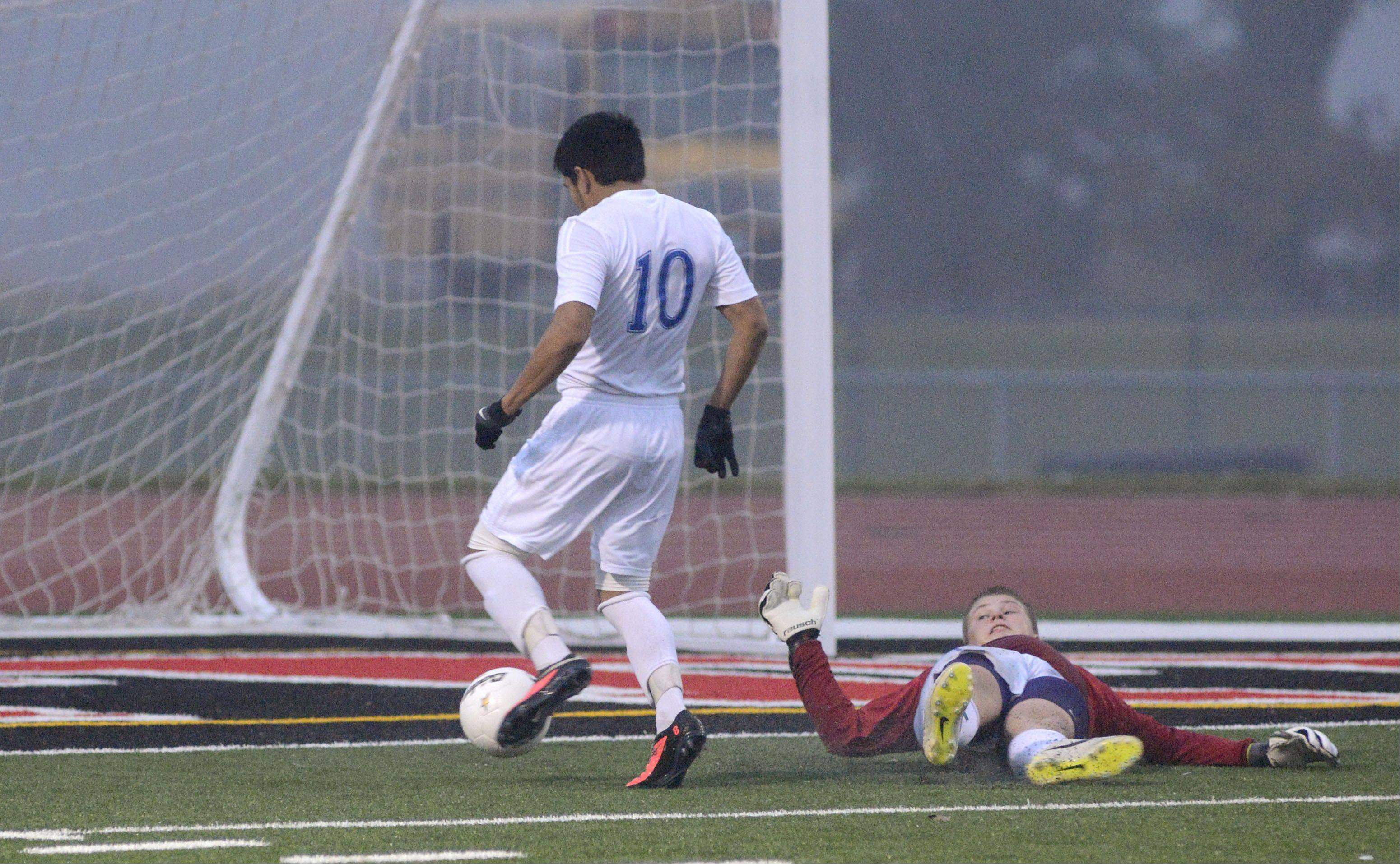 Larkin's Gonsalo Garcia trots past Hononegah goalie Henry Reynolds to score an easy goal, the second for the Royals, in the first half of the Huntley sectional semifinals on Wednesday.