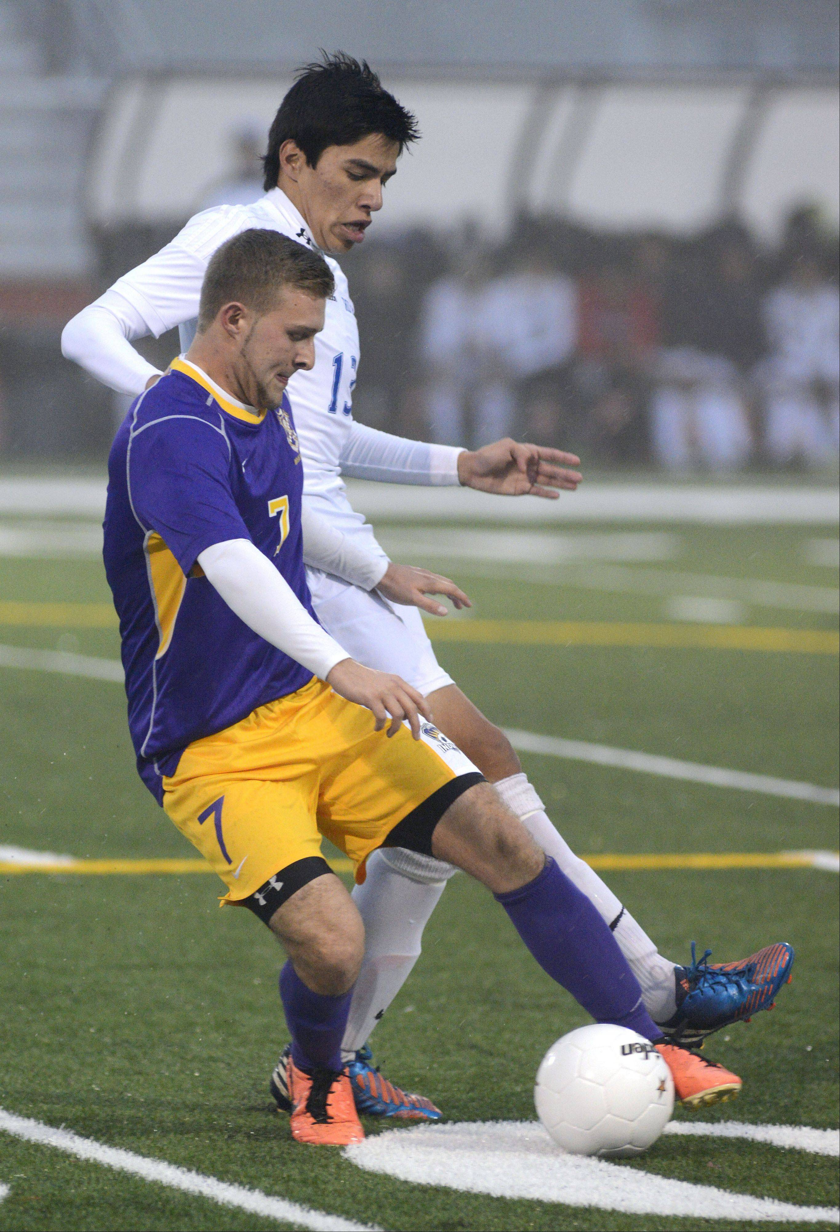 Hononegah's Cody Green and Larkin's Hector Mendoza fight for the ball in the first half of the Huntley sectional semifinals on Wednesday, October 30.