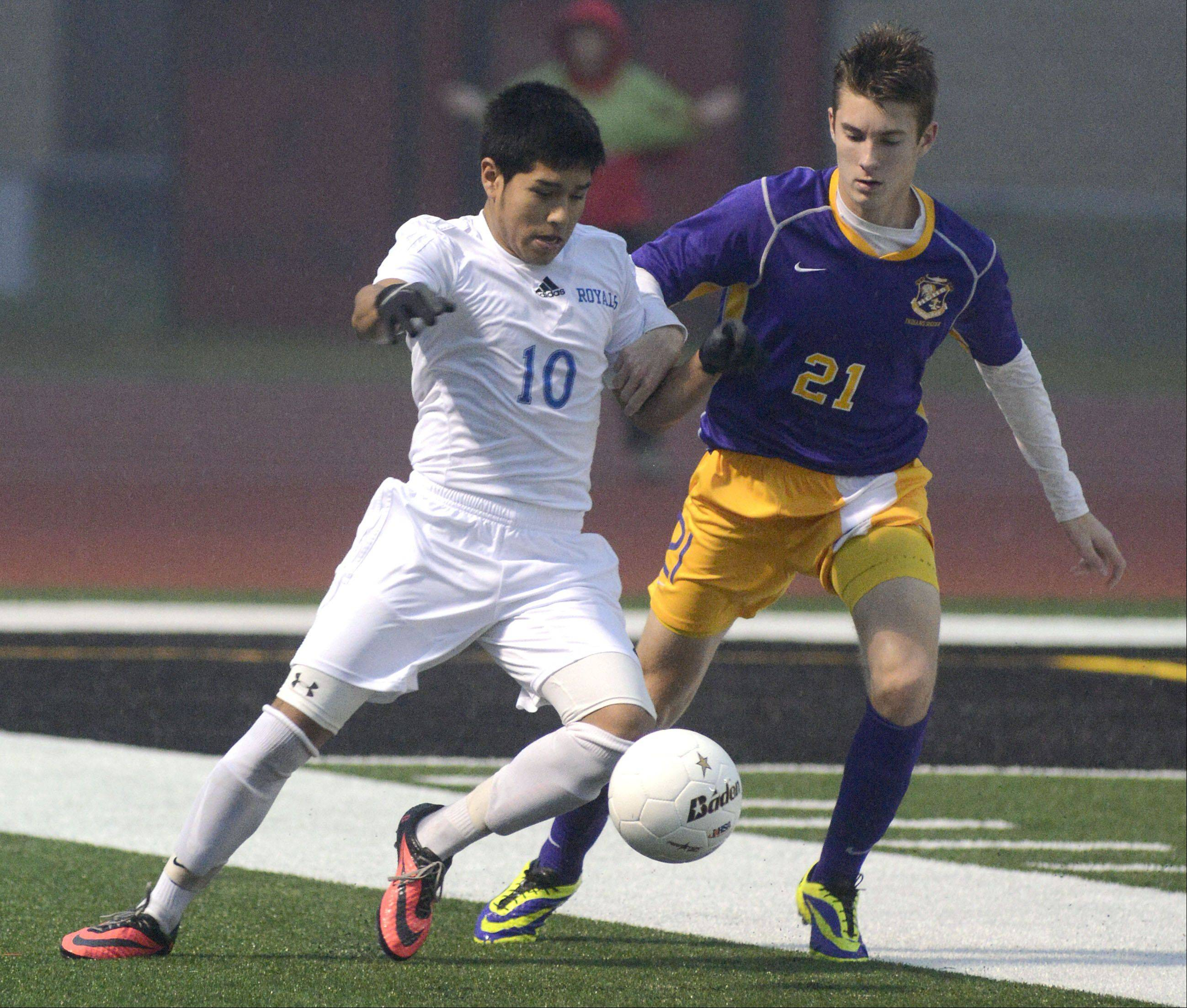 Larkin's Gonsalo Garcia and Hononegah's Brennan Nolting battle for the ball in the first half of the Huntley sectional semifinals on Wednesday, October 30.