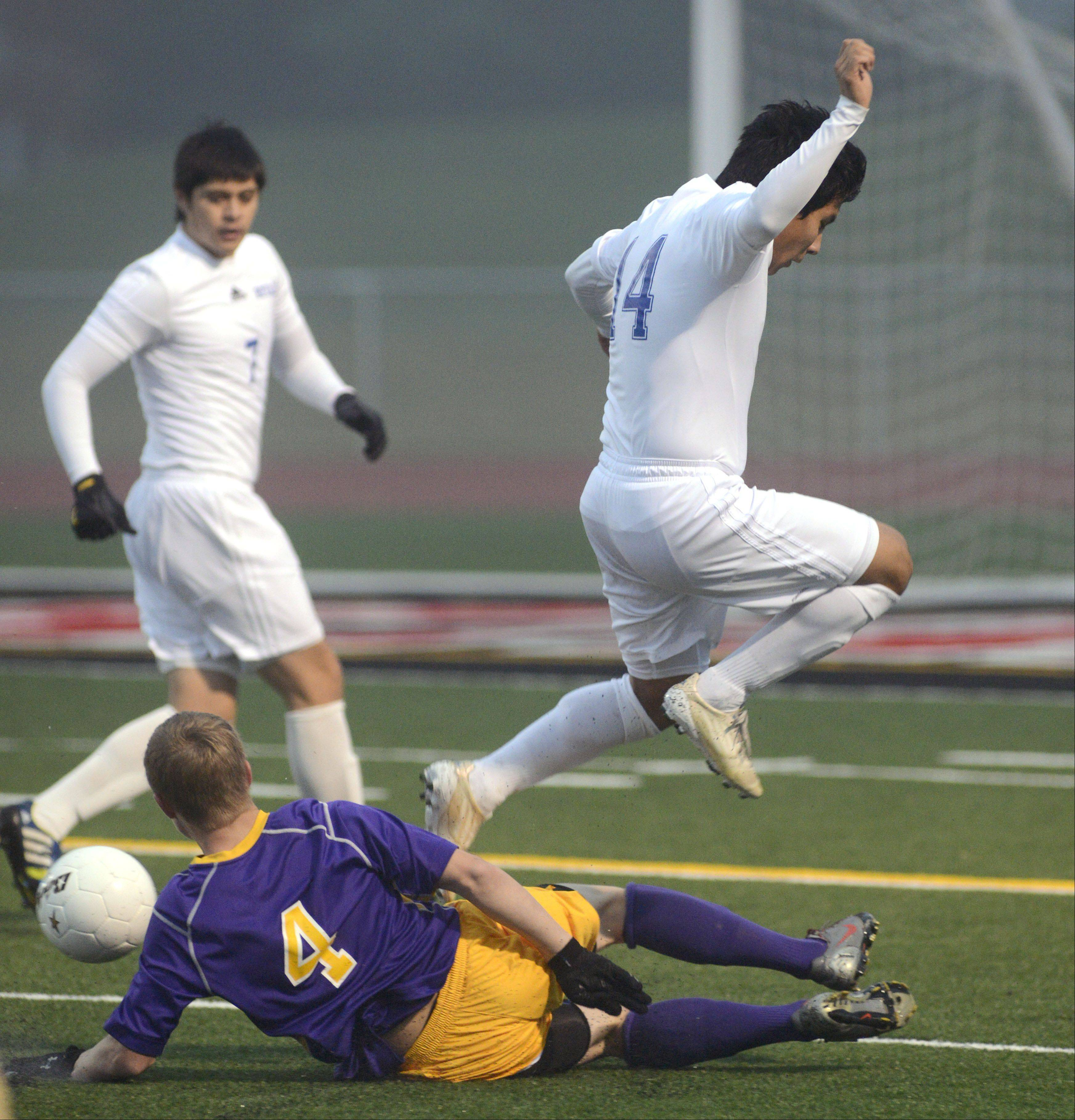 Larkin's Freddy Alvarez leaps over Hononegah's to avoid a collision in the first half of the Huntley sectional semifinals on Wednesday, October 30. 4 14