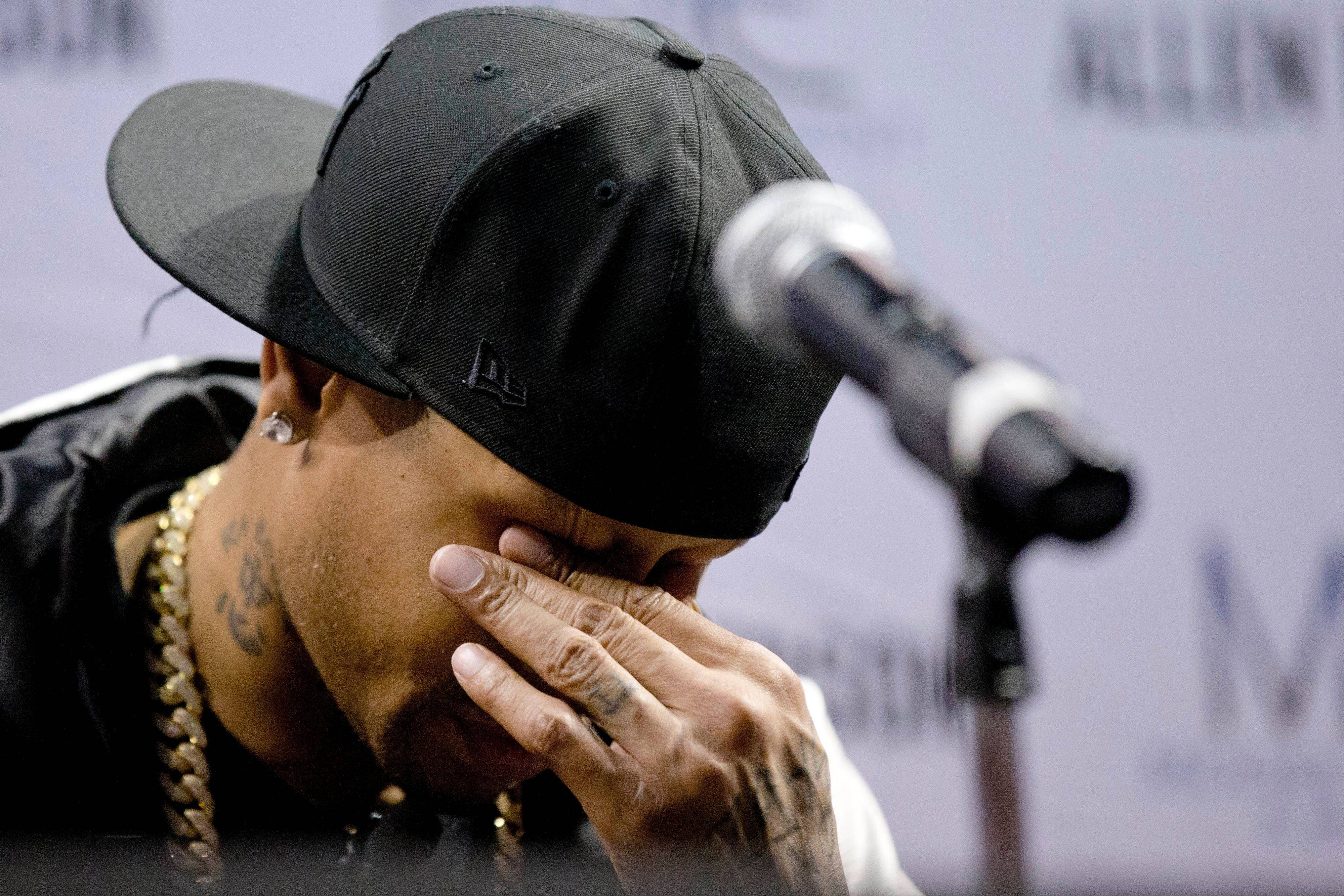 Former Philadelphia 76ers basketball player Allen Iverson wipes his eyes during a news conference Wednesday, Oct. 30, 2013, in Philadelphia. Iverson officially retired from the NBA, ending a 15-year career during which he won the 2001 MVP award and four scoring titles. Iverson retired in Philadelphia where he had his greatest successes and led the franchise to the 2001 NBA finals.