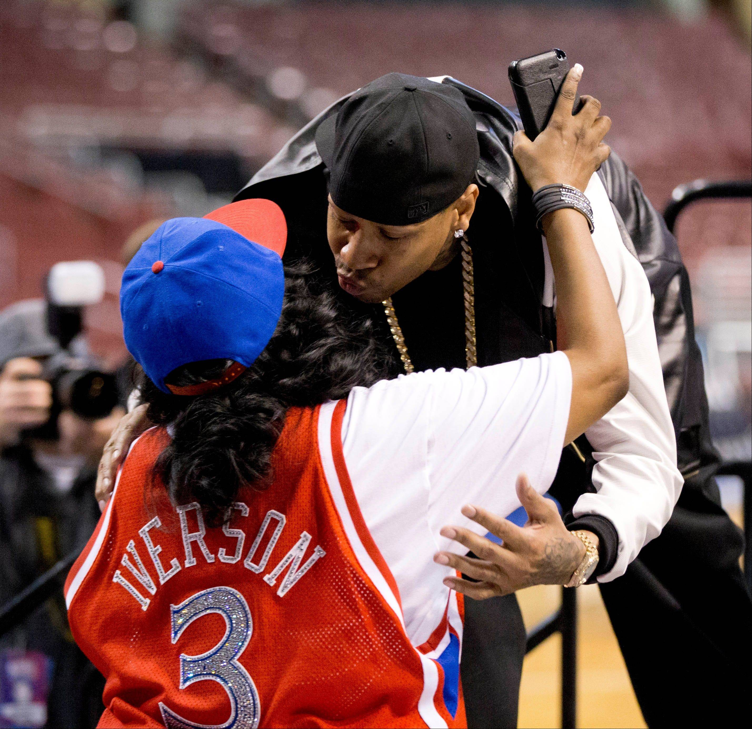Former Philadelphia 76ers basketball player Allen Iverson greets his mother Ann Iverson as he arrives for a news conference Wednesday, Oct. 30, 2013, in Philadelphia. Iverson officially retired from the NBA, ending a 15-year career during which he won the 2001 MVP award and four scoring titles. Iverson retired in Philadelphia where he had his greatest successes and led the franchise to the 2001 NBA finals.