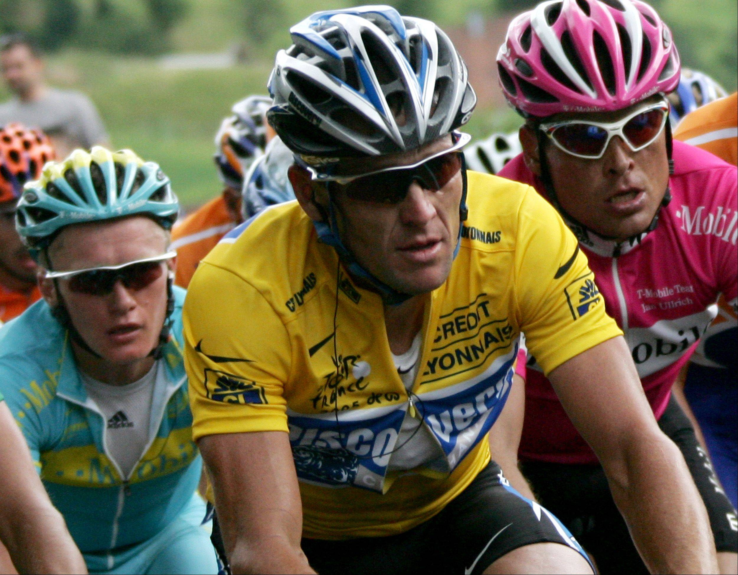 Lance Armstrong, foreground, was stripped of his seven Tour de France titles.