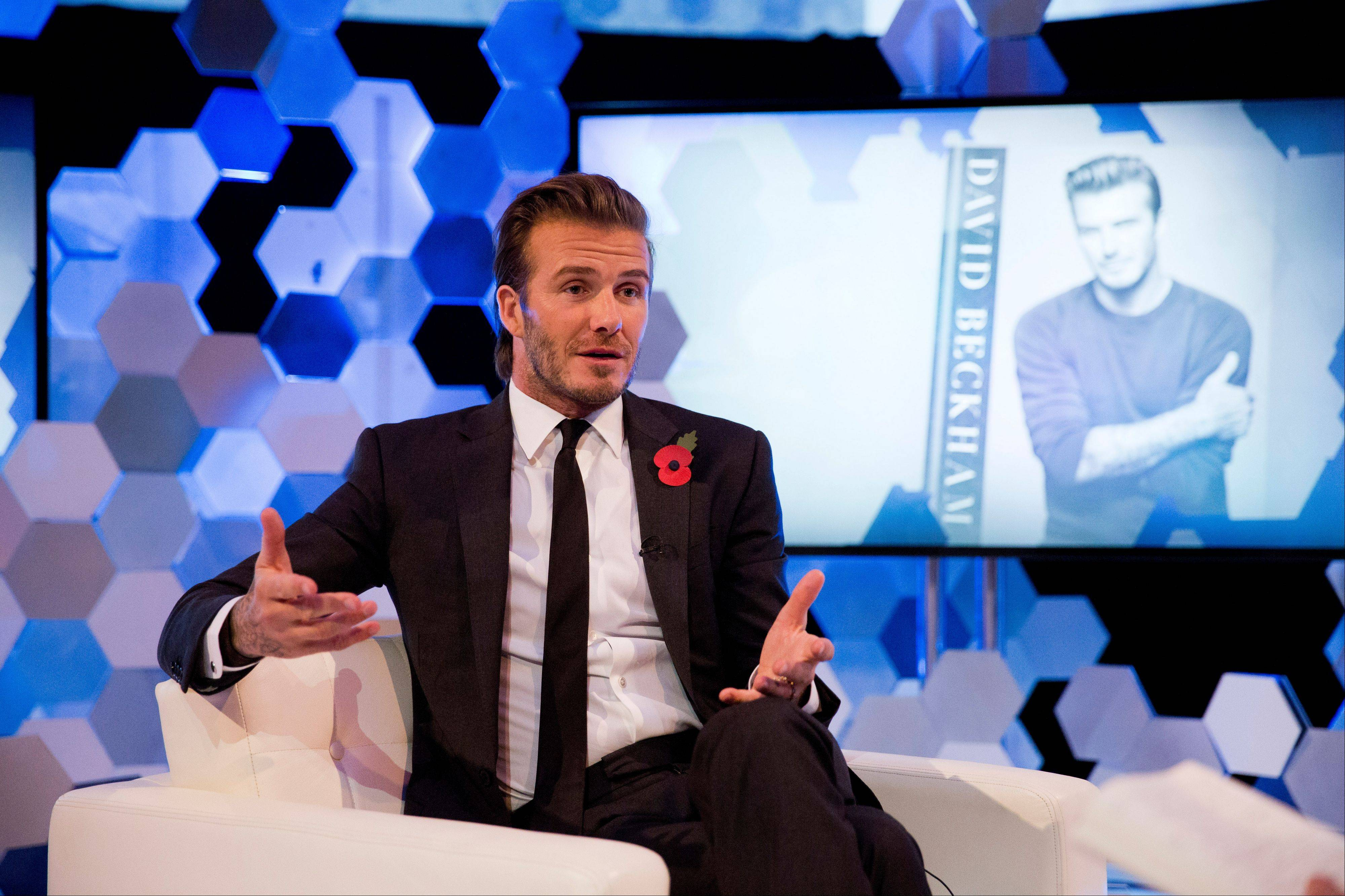 Soccer legend David Beckham promotes his new photography book during an interview Wednesday in London.