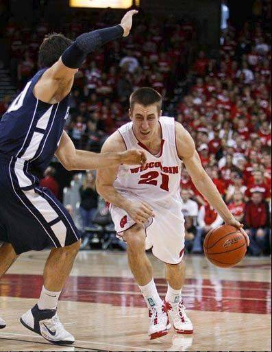 Wisconsin's Josh Gasser, right, drives on Penn State's Nick Colella during the second half of a game in 2012.