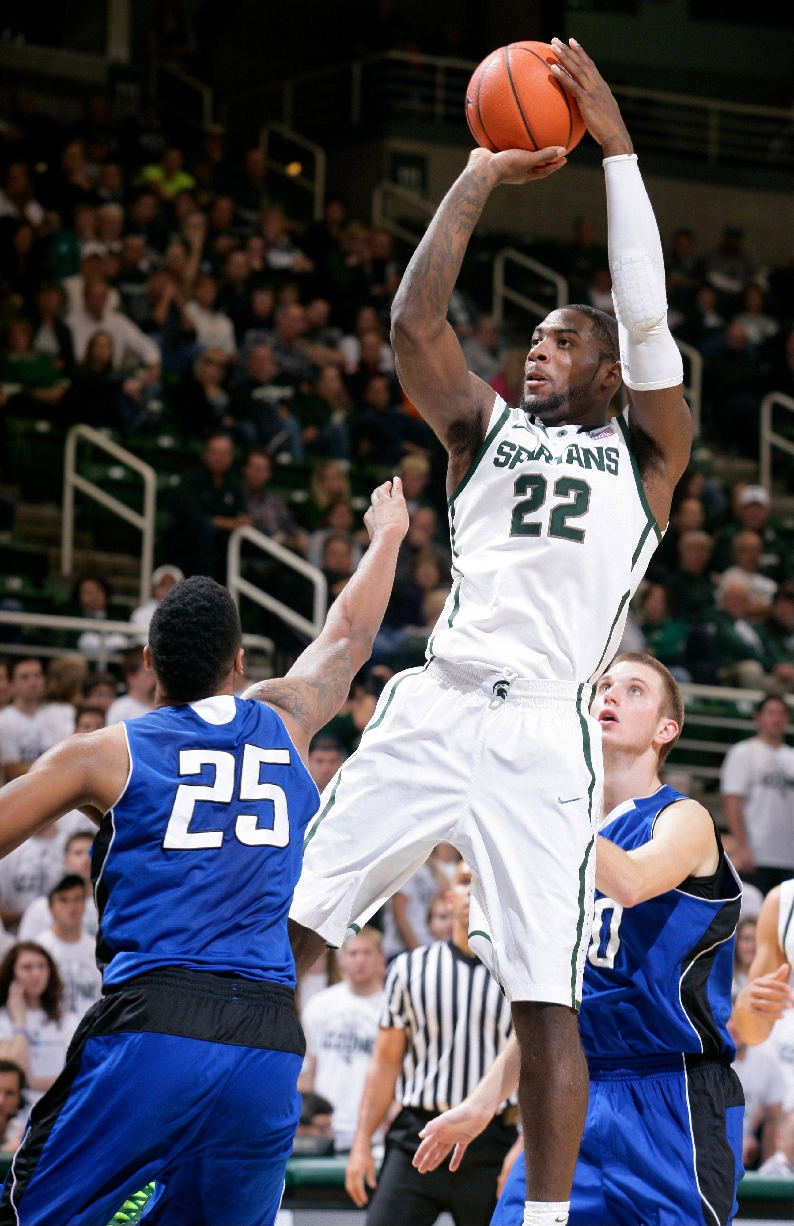 Michigan State's Branden Dawson shoots over Grand Valley State's Chaz Rollins during the second half of an exhibition game\ Tuesday in East Lansing, Mich. Michigan State won 101-52.
