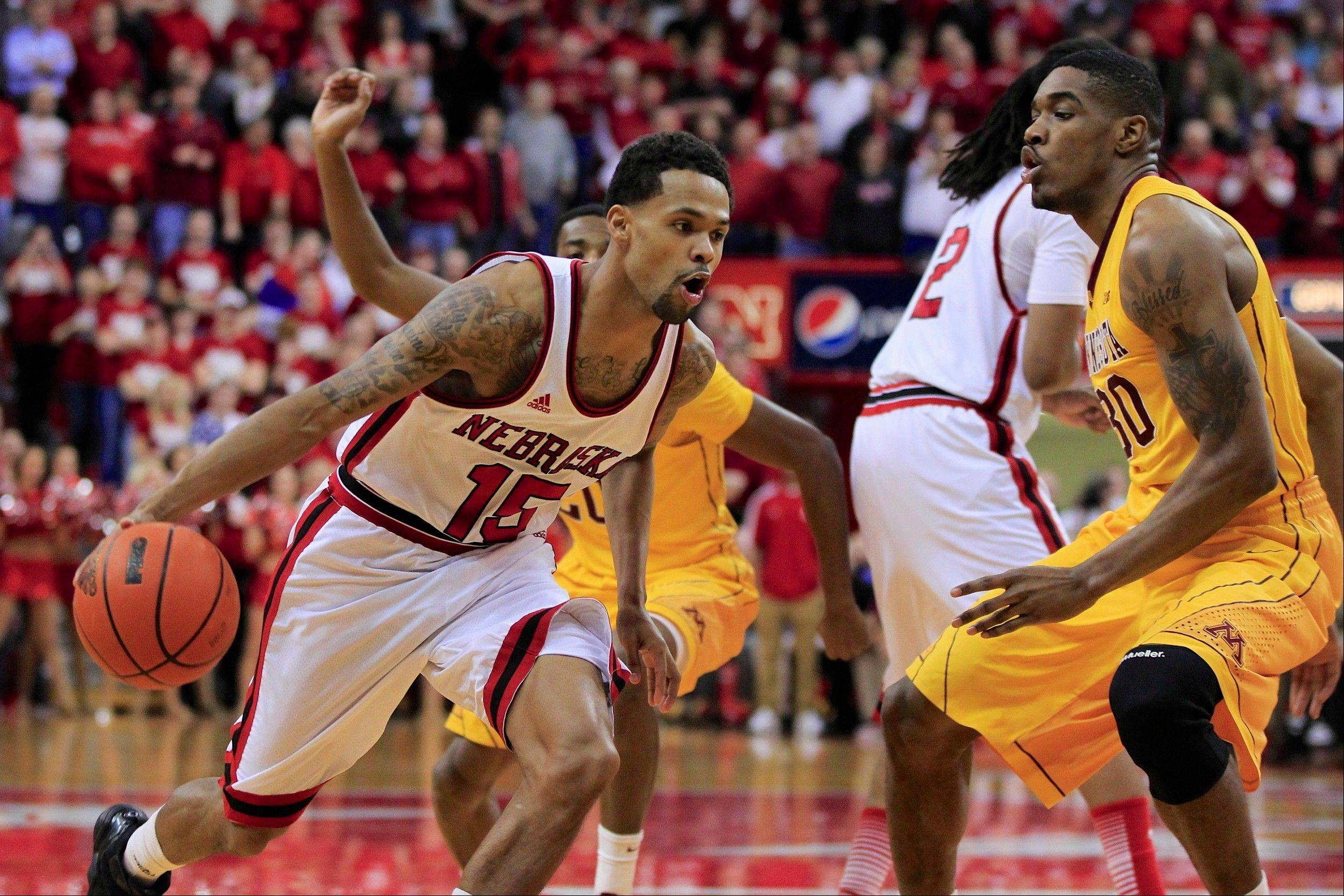 Nebraska's Ray Gallegos drives past Minnesota's Andre Ingram, right, in a game last season.