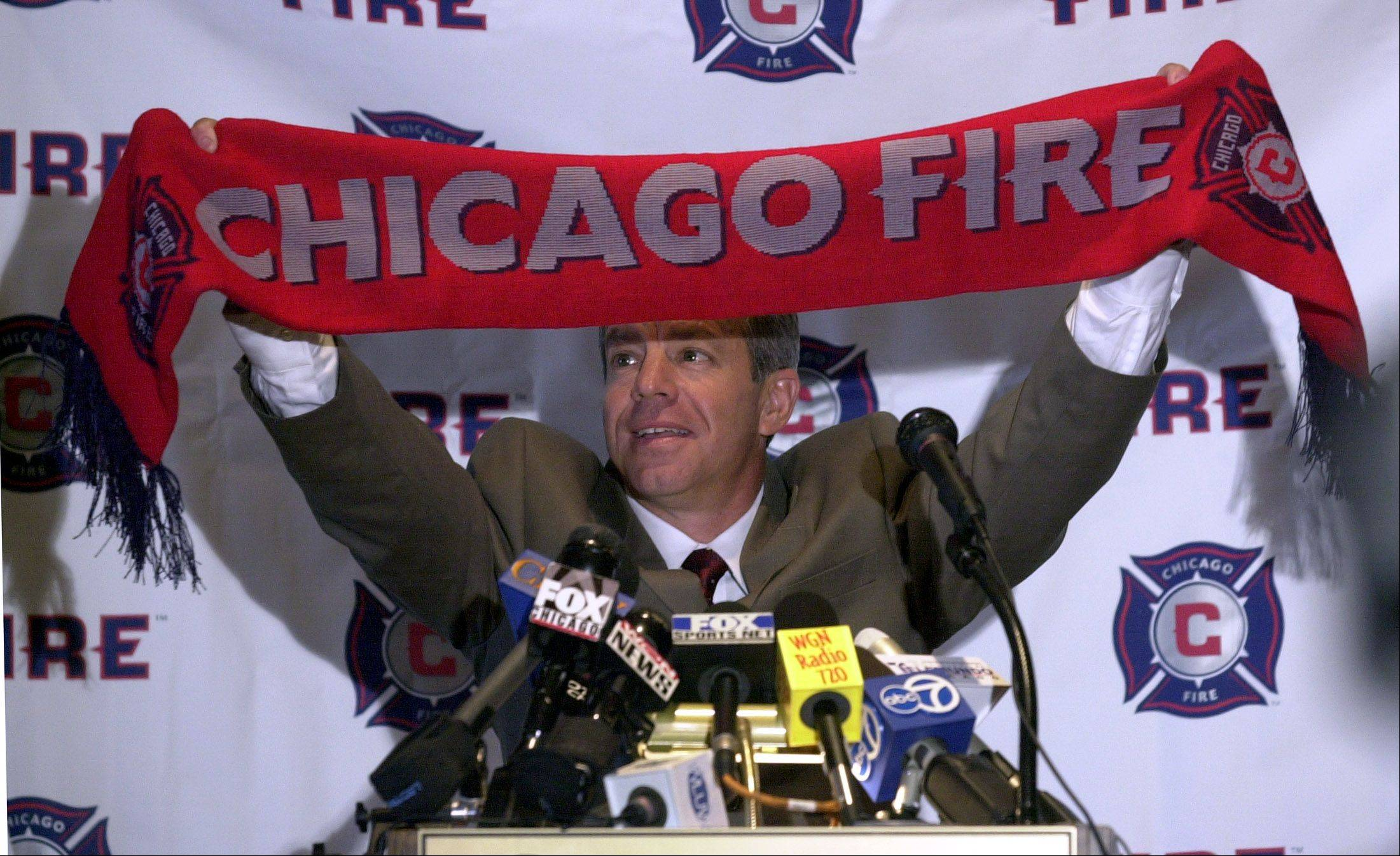 Newly-named Chicago Fire Head Coach Dave Sarachan holds up a scarf at the press conference to announce his appointment.