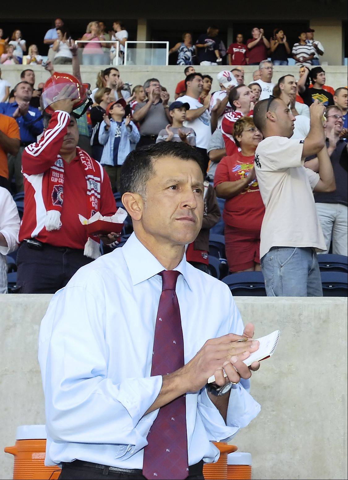 New head coach Juan Carlos Osorio stands on the sidelines as the Chicago Fire host the Houston Dynamo, on Thursday, July 12, 2007. Osorio coached the team for the 2007 season.