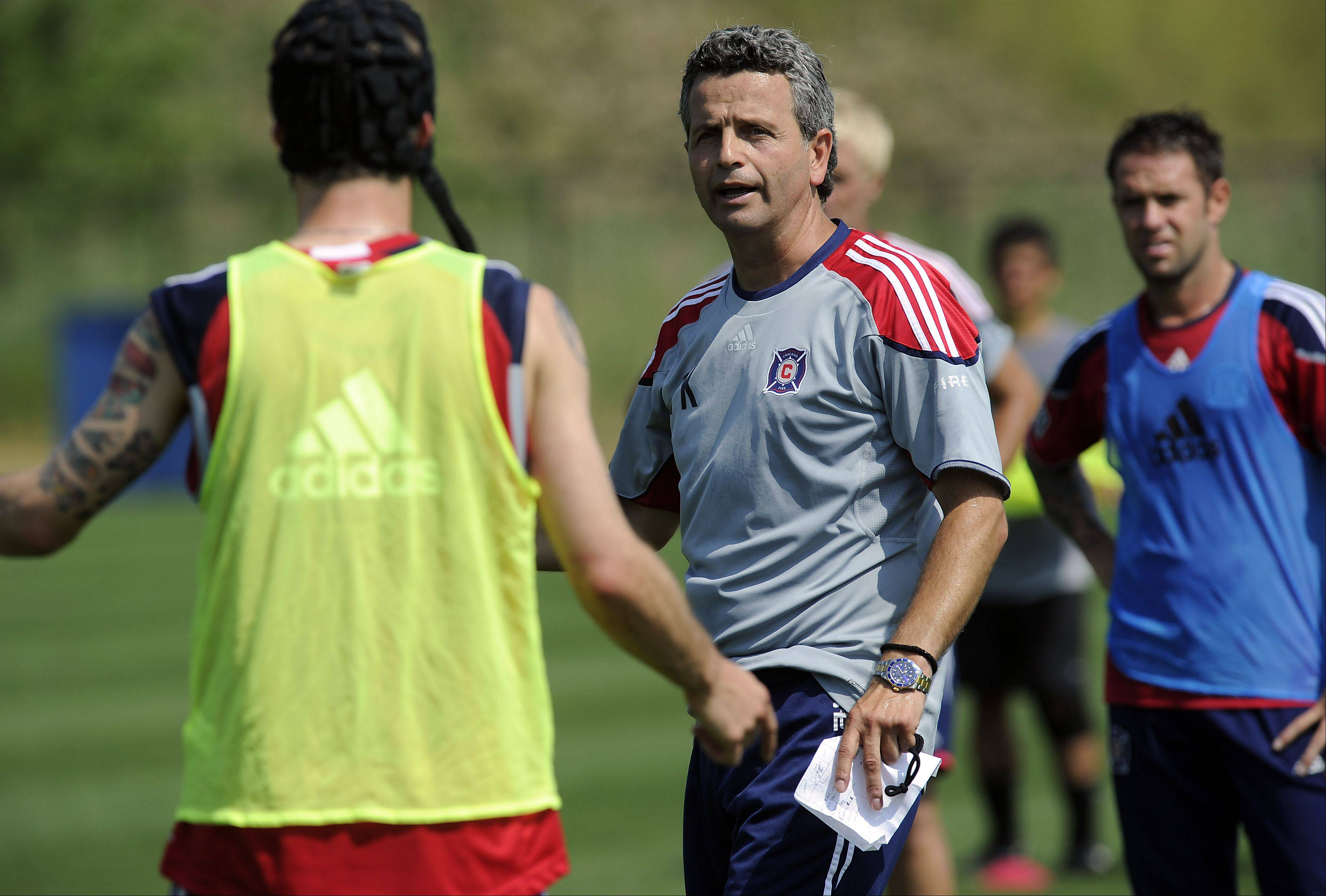 The Chicago Fire soccer team warms up at the Toyota Park practice field in Bridgeview Tuesday getting ready for their big matchup with Manchester United at Soldier Field in Chicago on Saturday. Coach Frank Klopas barks out orders during that practice.