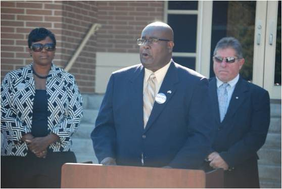 Candidate Willie M. Mayes Sr., (center); wife, Sharron Mayes; and Sheriff Patrick Perez