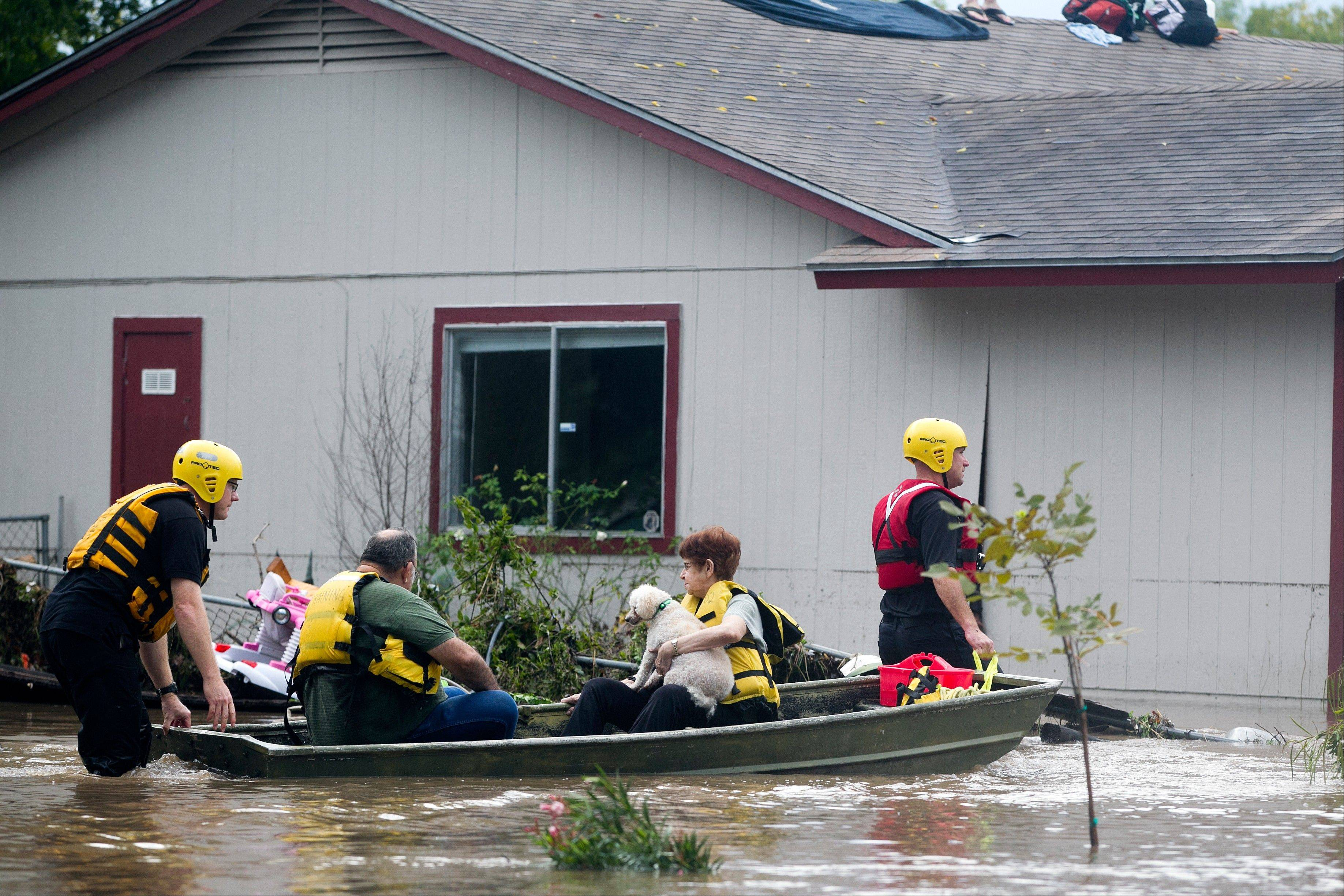 People are rescued from a home�s rooftop in Austin, Texas, Thursday after heavy overnight rains brought flooding to the area. The National Weather Service said more than a foot of rain fell in Central Texas.