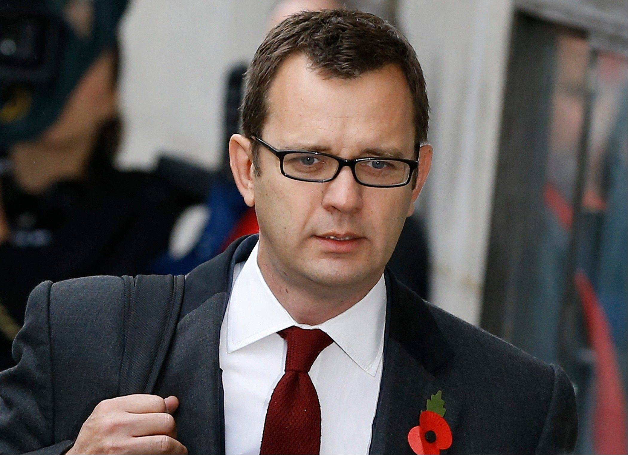 Andy Coulson arrives at The Old Bailey law court in London, Thursday, Oct. 31, 2013. Former News of the World national newspaper editors Rebekah Brooks and Andy Coulson went on trial Monday on charges relating to the hacking of phones and bribing officials while they were employed at the now closed tabloid paper.