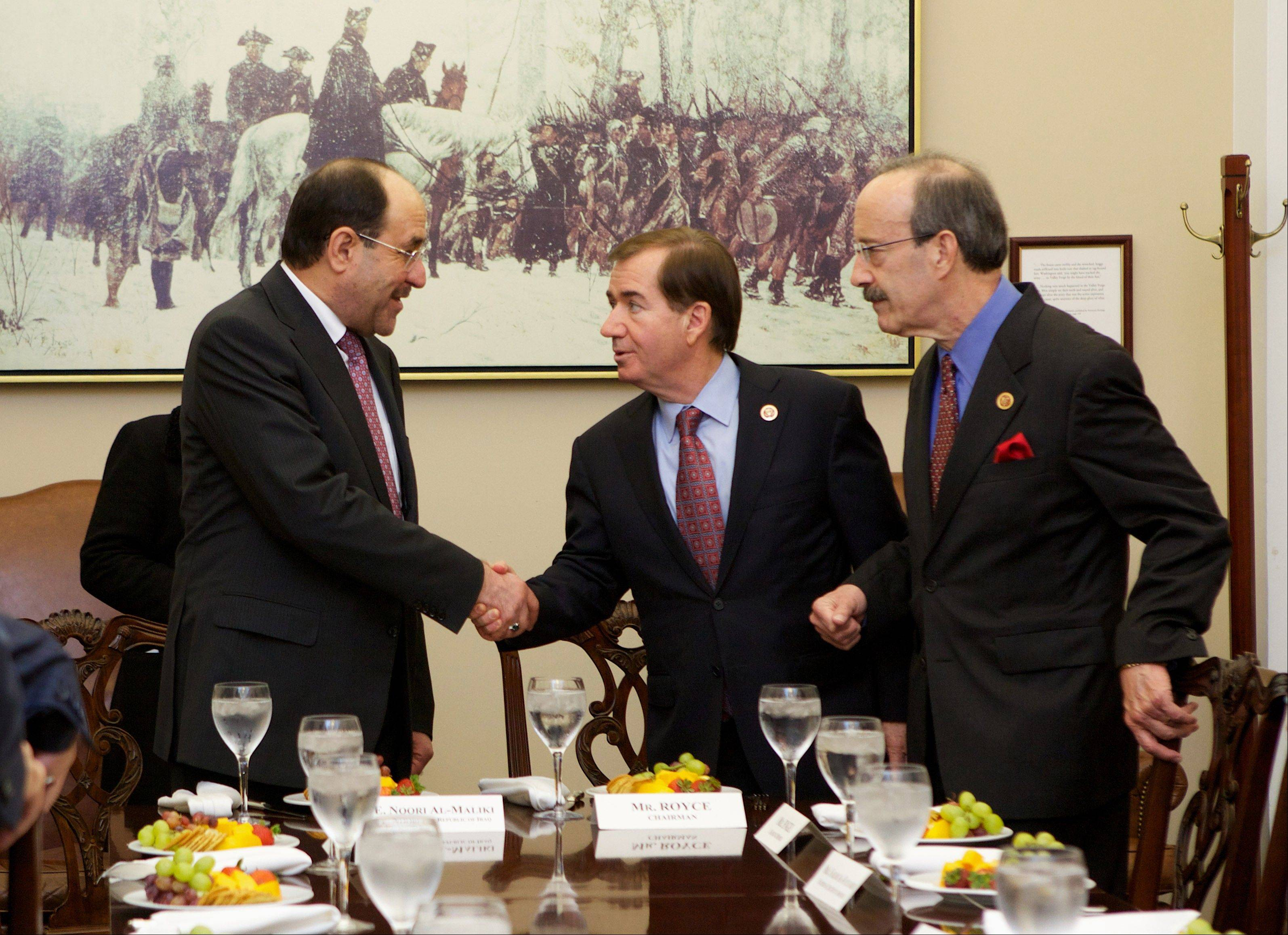 Iraq�s Prime Minister Nouri al-Maliki, left, is greeted by House Foreign Affairs Committee Chairman Rep. Ed Royce of California, center, and the committee�s ranking Democrat, Rep. Eliot Engel of New York, on Capitol Hill Wednesday.