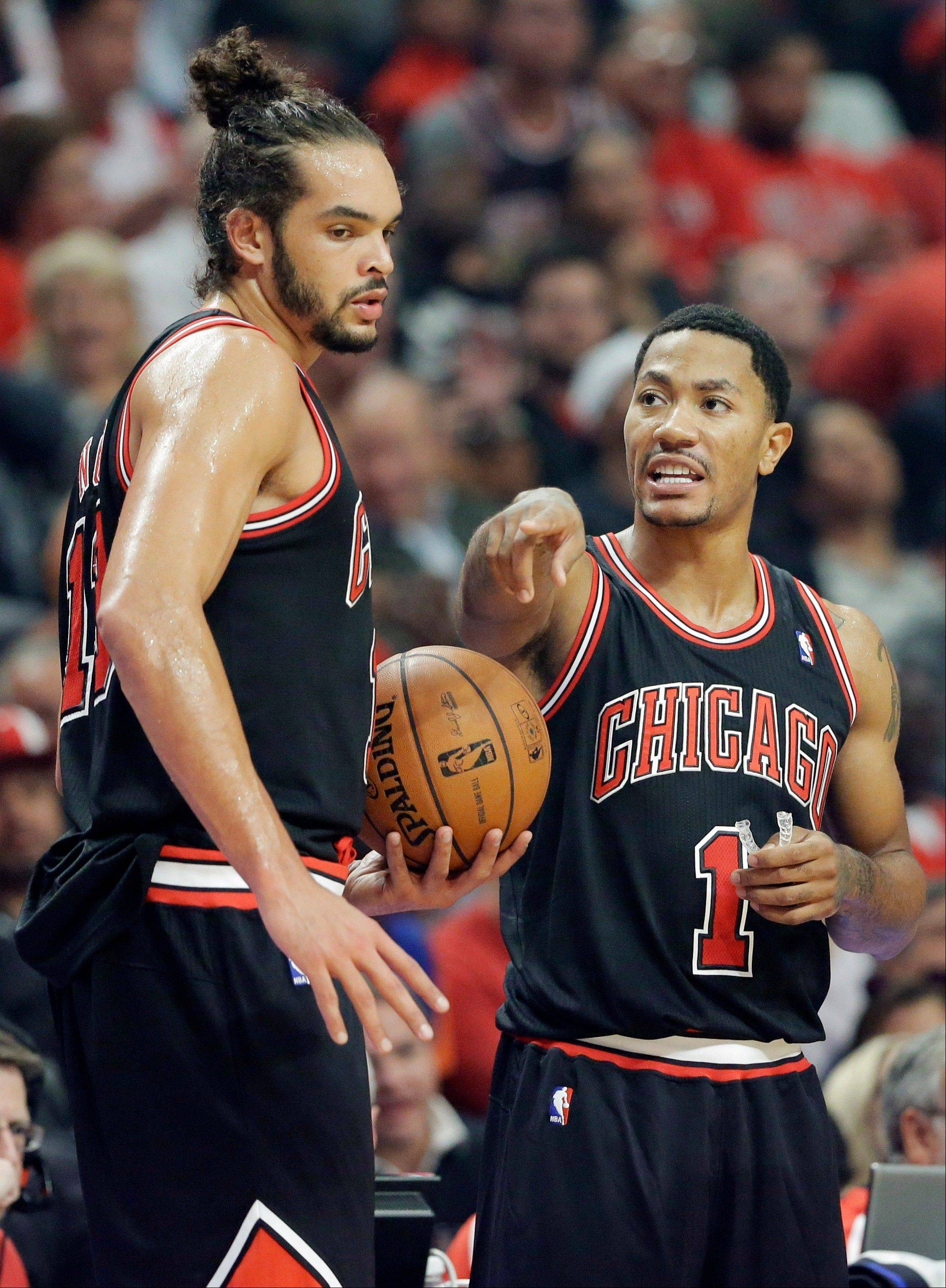 Bulls guard Derrick Rose, right, talks with center Joakim Noah during Thursday�s first half at United Center.