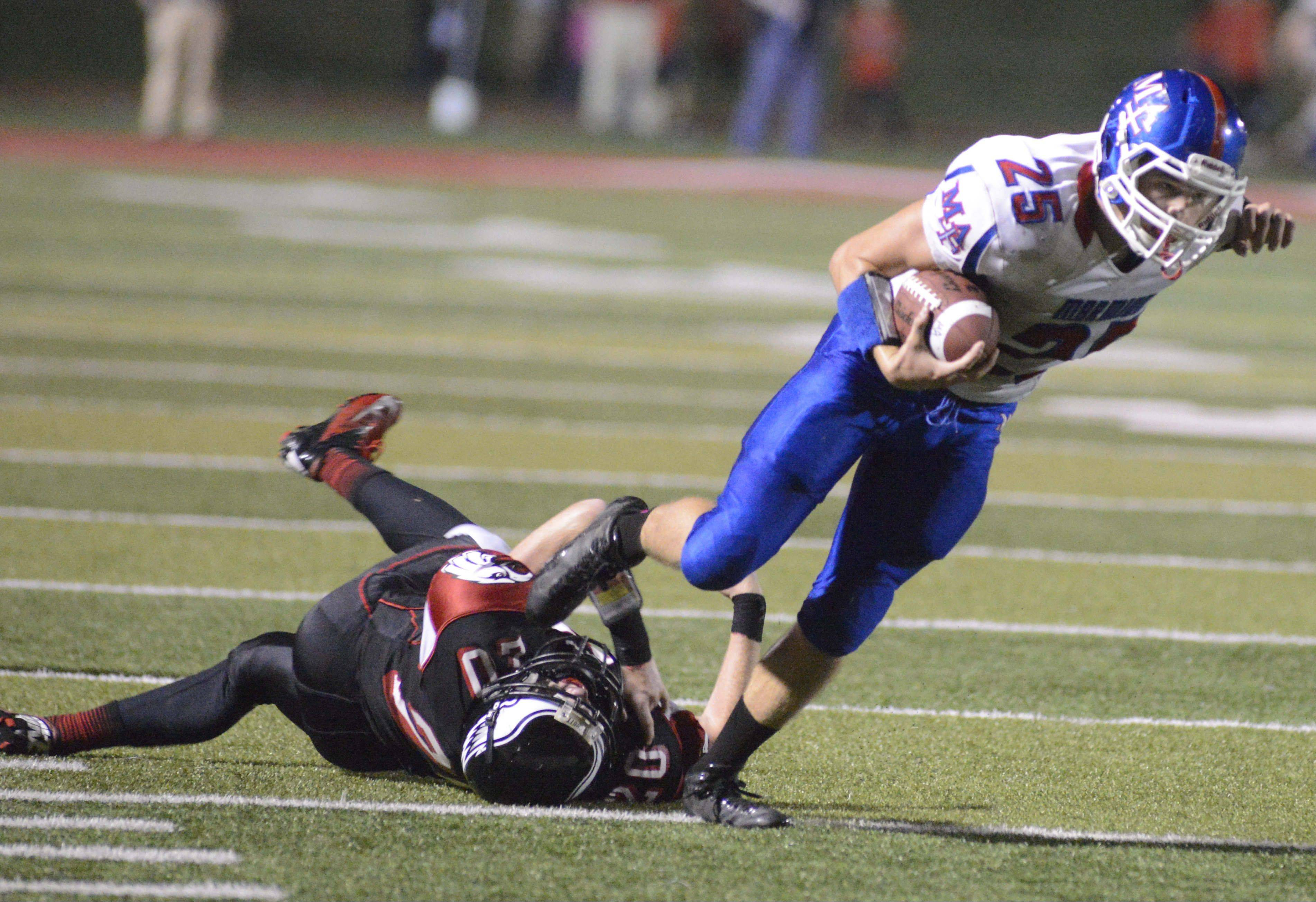 Sam Breen fights for yards for Marmion during the Cadets� win over Aurora Christian this season. Marmion starts Class 6A playoff action Friday when it hosts Fenton.