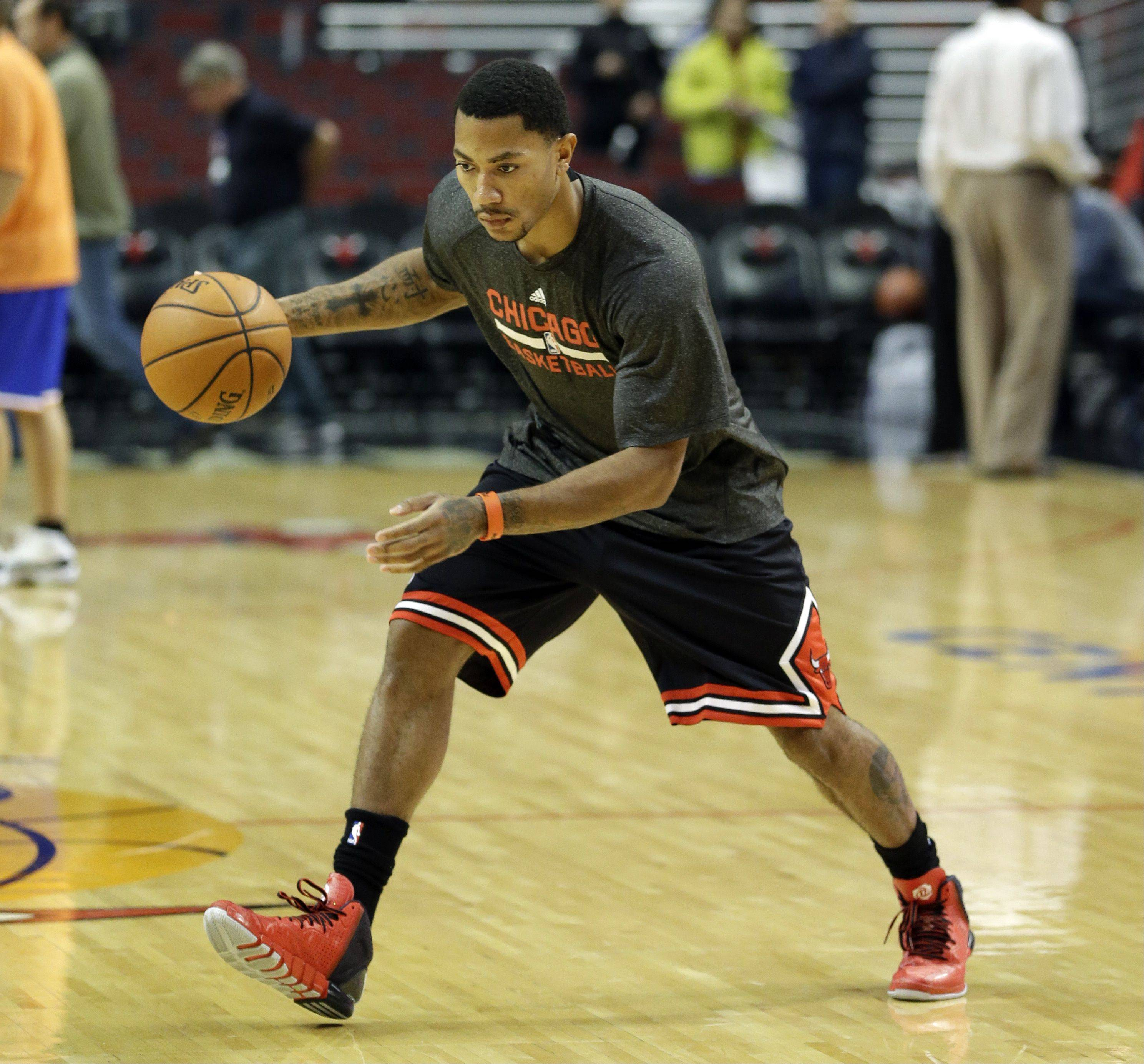 Bulls guard Derrick Rose warms up before Thursday�s game against the New York Knicks at United Center.