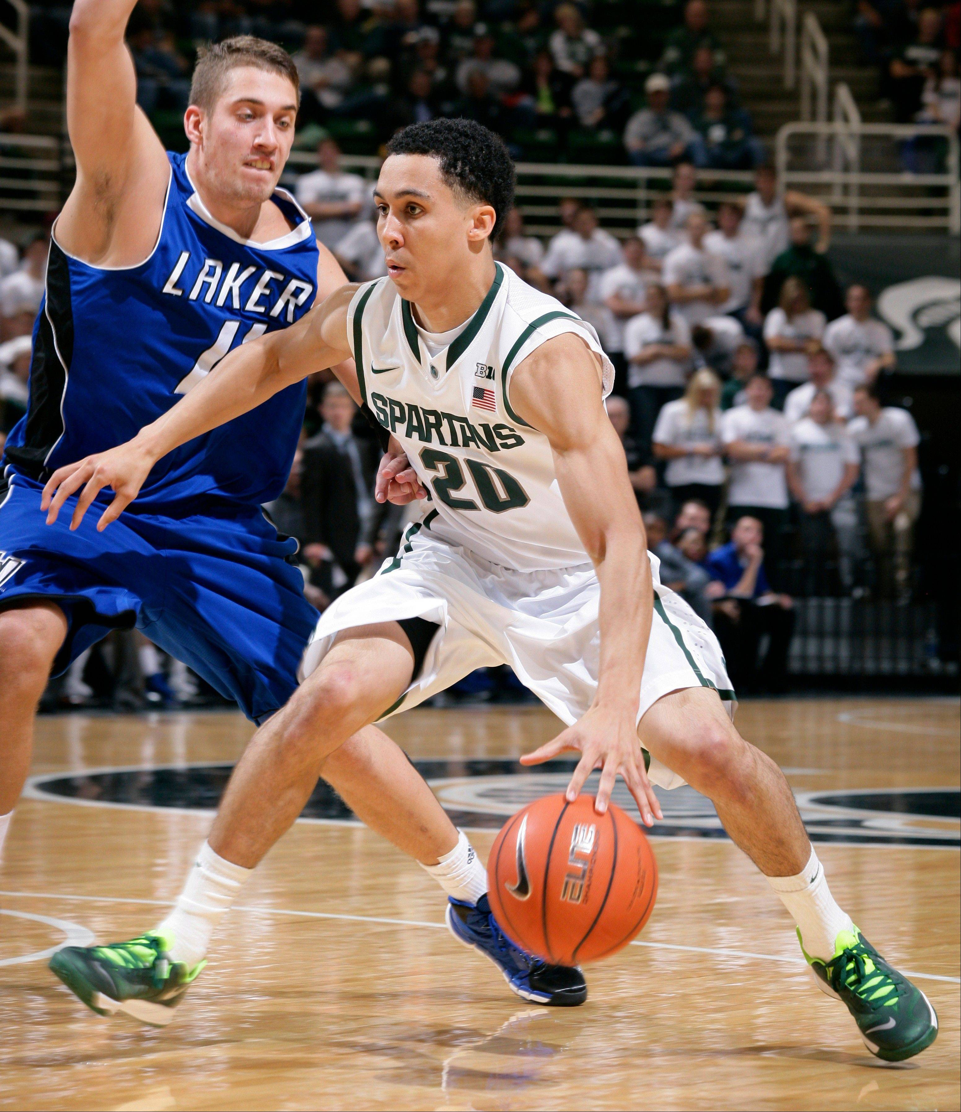 Michigan State�s Travis Trice drives against Grand Valley State�s Ernijs Ansons during an exhibition game on Tuesday in East Lansing, Mich. The Spartans are the preseason pick to win the Big Ten.