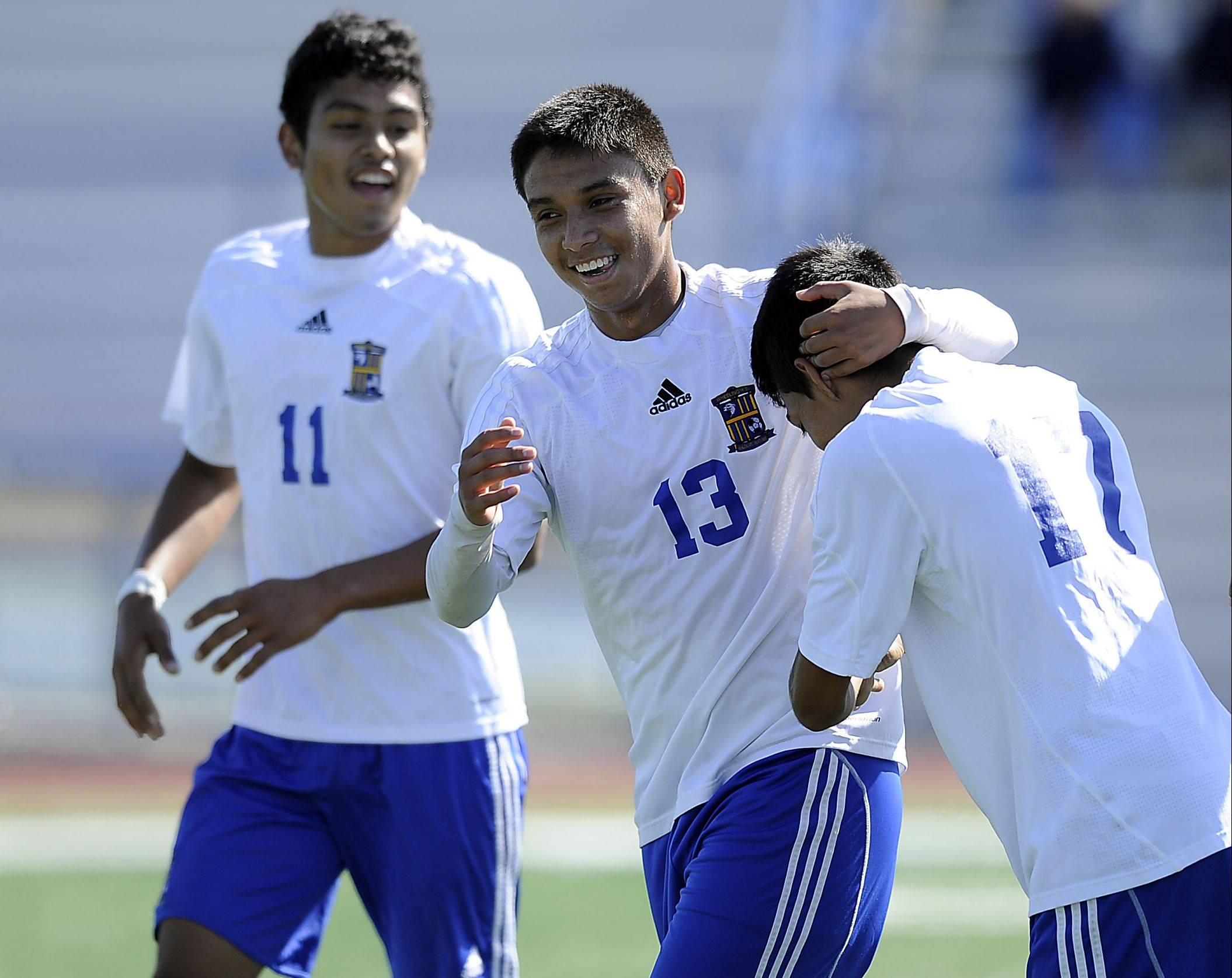 From left, Wheeling�s Luis Herrera, Jose Garcia and Fabian Acosta celebrate a goal early this season. Garcia�s knack for generating goals has the Wildcats in Saturday�s Evanston sectional final.