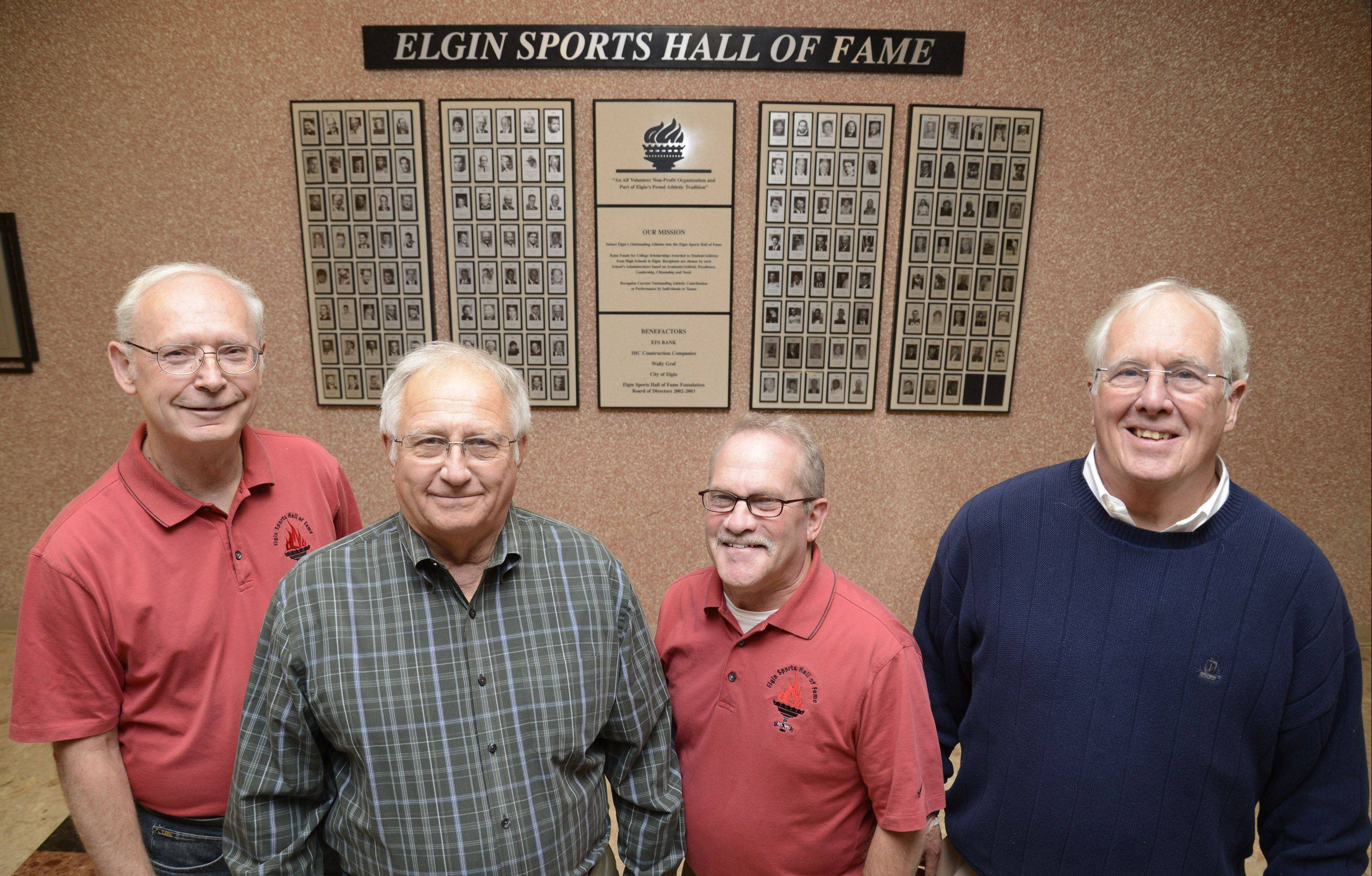 From left, current Elgin Sports Hall of Fame Foundation president Ron Lange, treasurer Dave Covey, past president Mark Sharf, and scholarship committee member Gus Vaughan pose in from of the Elgin Sports Hall of Fame's Wall of Fame at The Centre of Elgin. The foundation will hold its 34th annual induction ceremony and banquet Sunday night at The Centre.