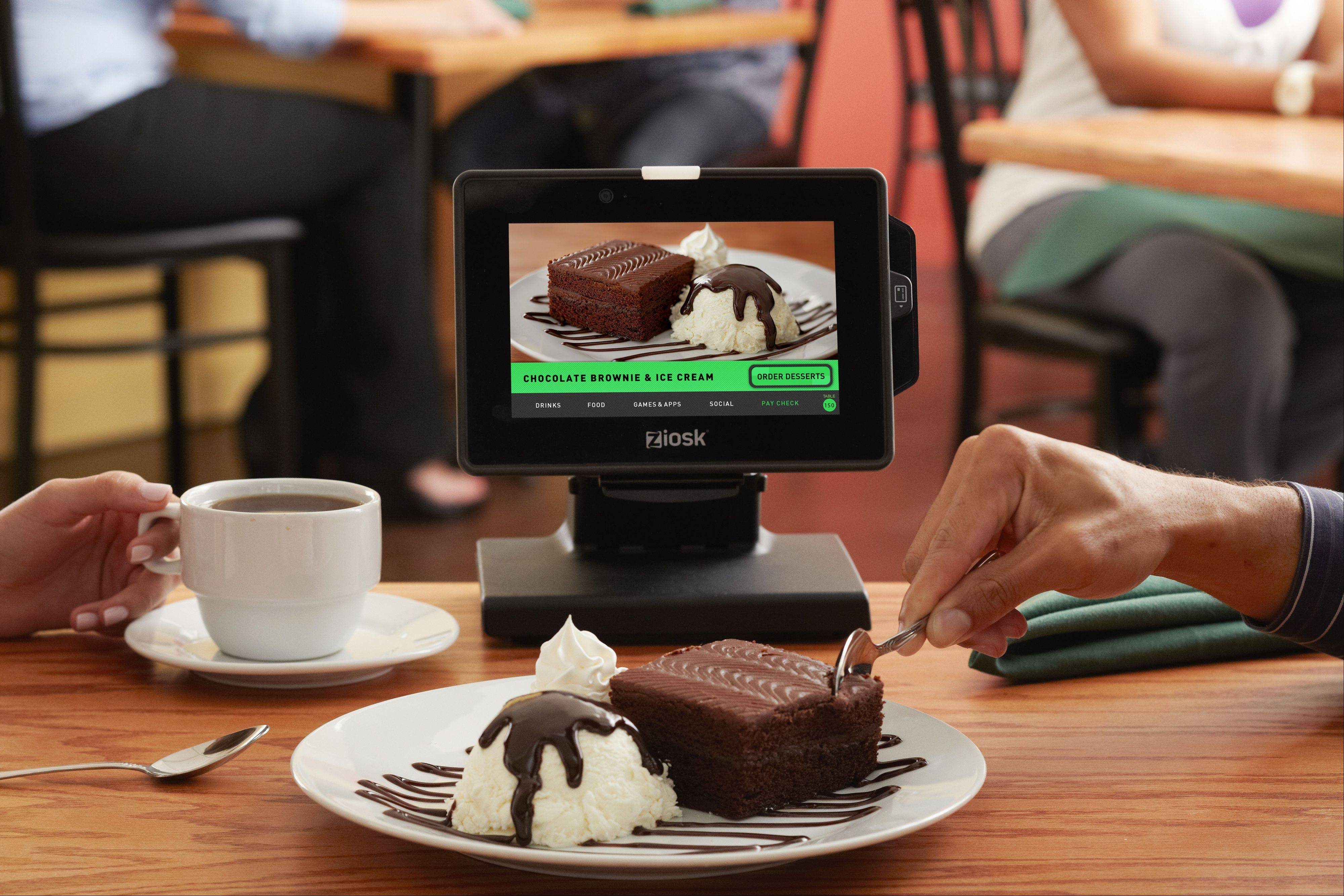 COURTESY OF ZIOSK Dallas, Texas-based Ziosk has updated its tabletop tablet where restaurant customers can order food, pay their bill and even get entertainment while waiting for their meal. Chili's restaurants in the suburbs now offer the upgraded tablet with a touch screen and more features.