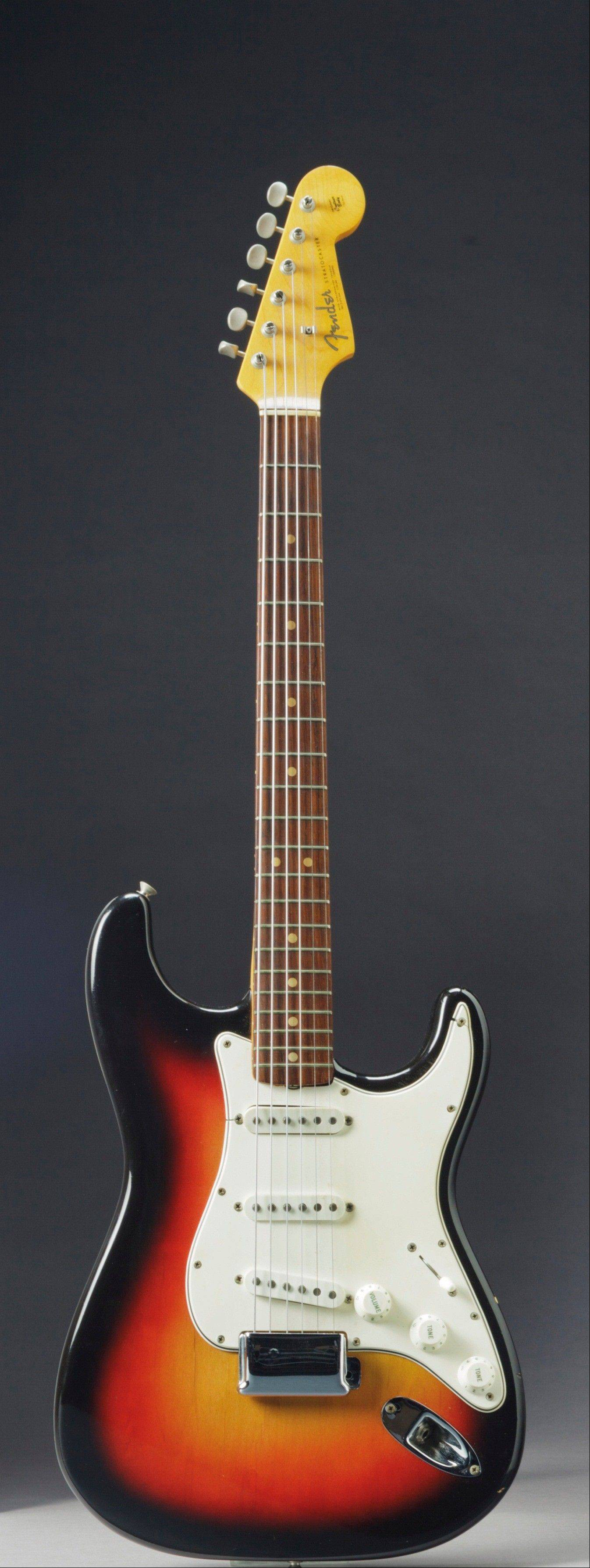 The Fender Stratocaster a young Bob Dylan played at the historic 1965 Newport Folk Festival could bring as much as half a million dollars when it comes up for auction at Christie's New York on Dec. 6. The festival marked the first time Dylan went electric, a defining moment that marked his move from acoustic folk to electric rock and roll, drawing boos from folk-music purists.