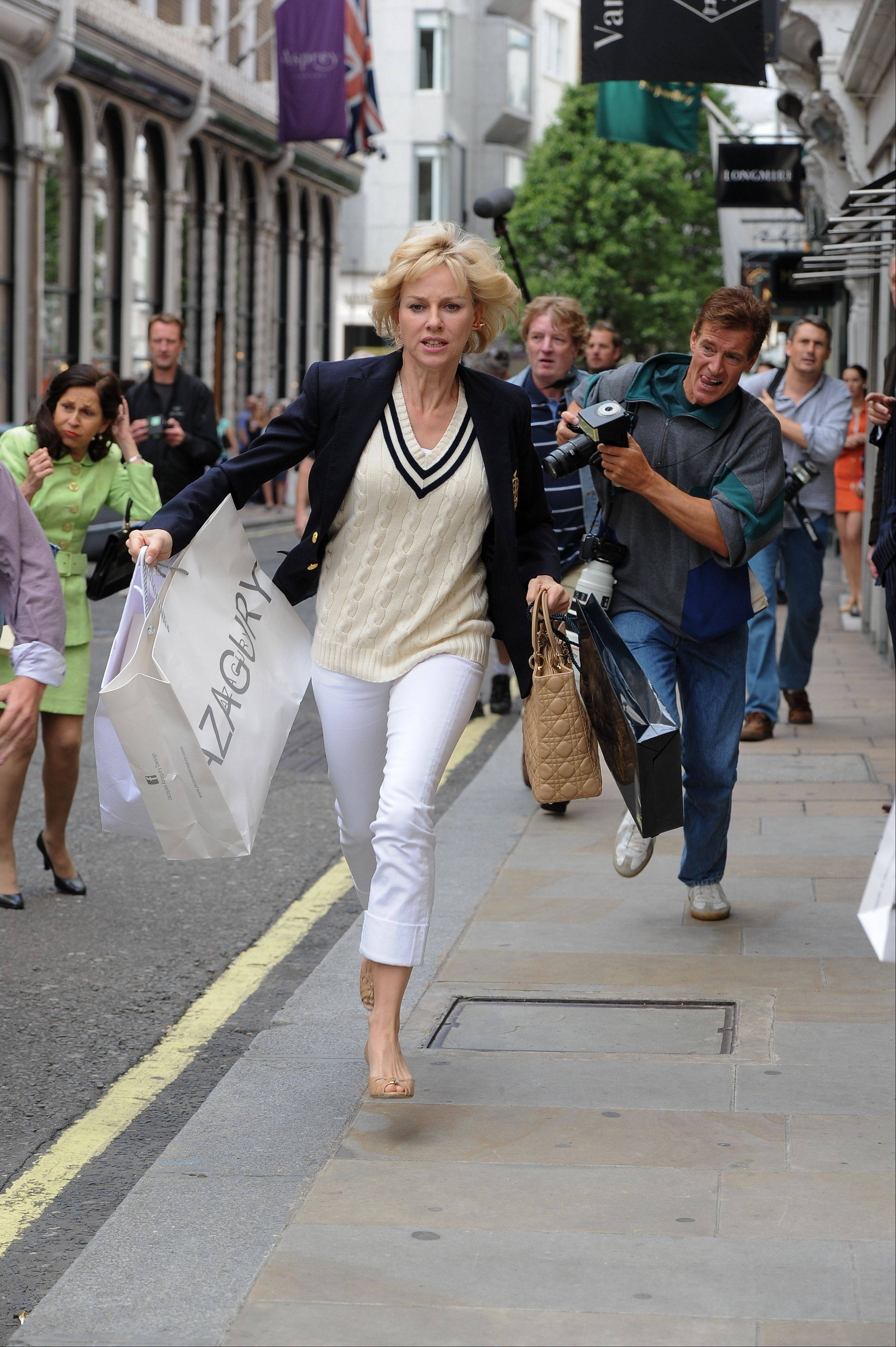 "Diana, Princess of Wales (Naomi Watts), tries to escape the paparazzi in ""Diana."""